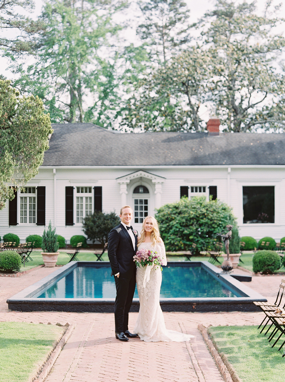 julia mitchell wedding couple in front of venue