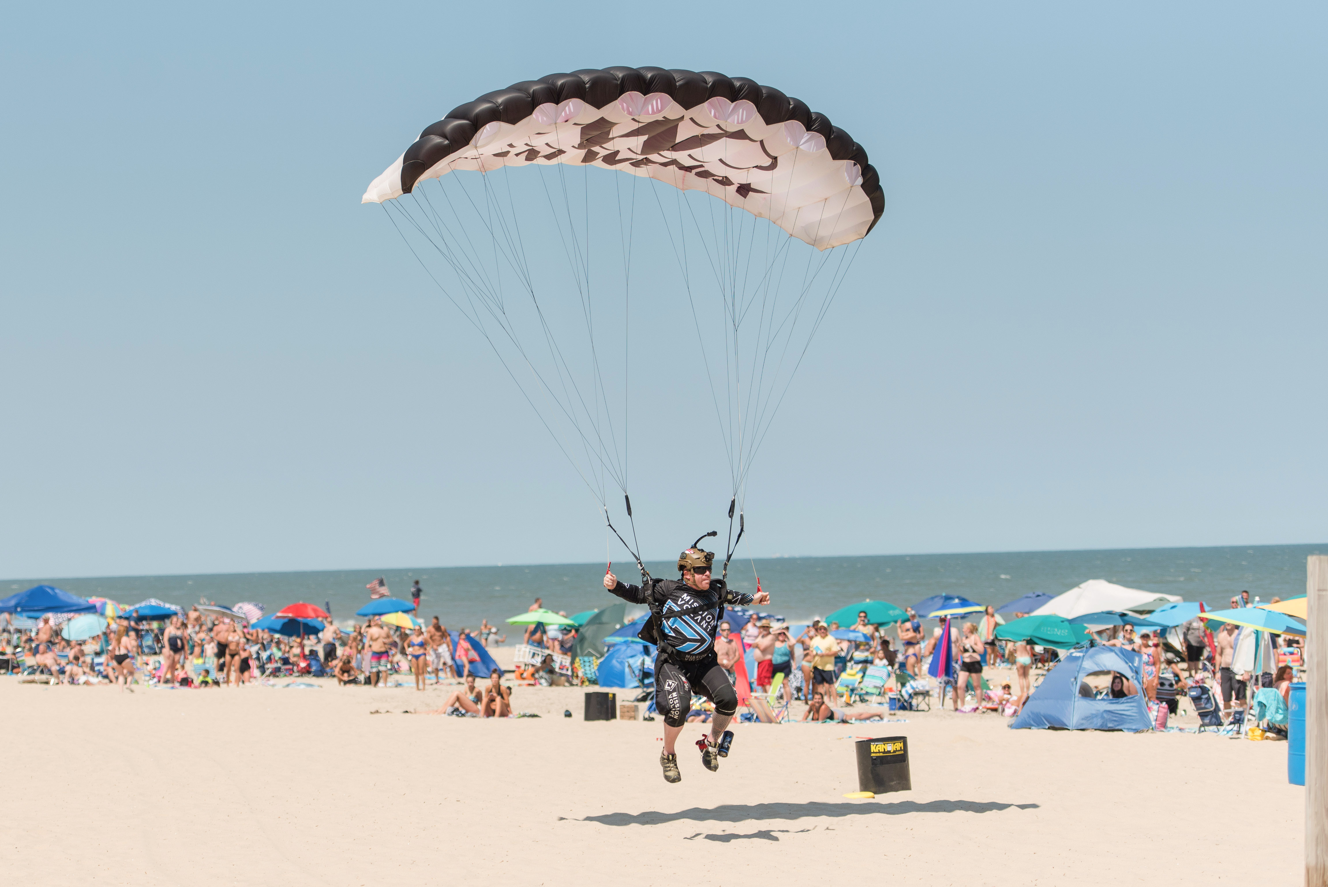 skydiver landing at beach