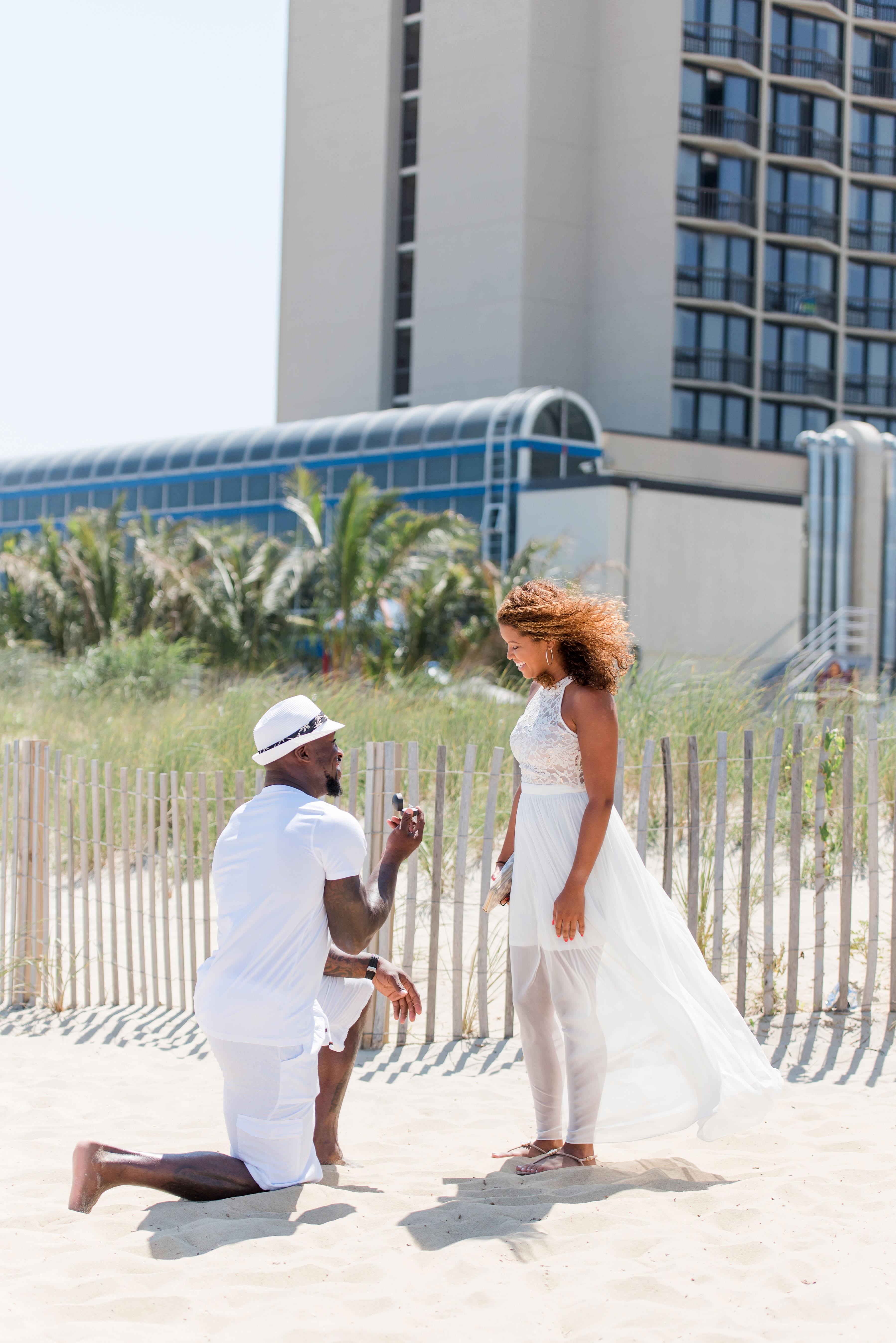 man proposing on beach