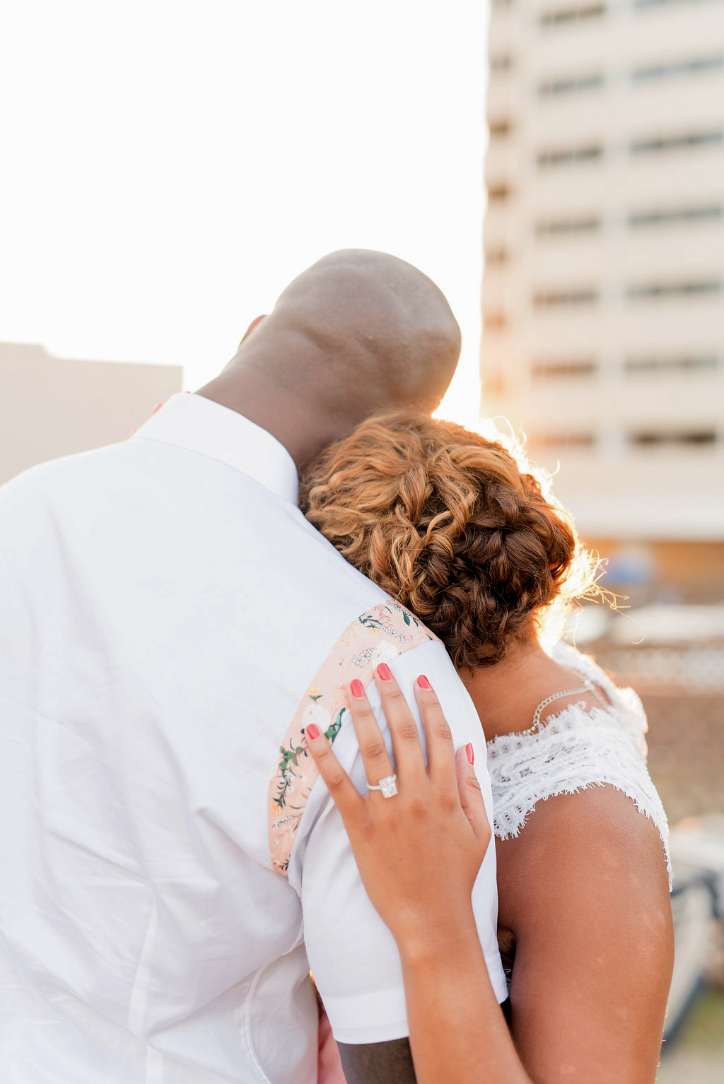 loving couple looking into cityscape sunset