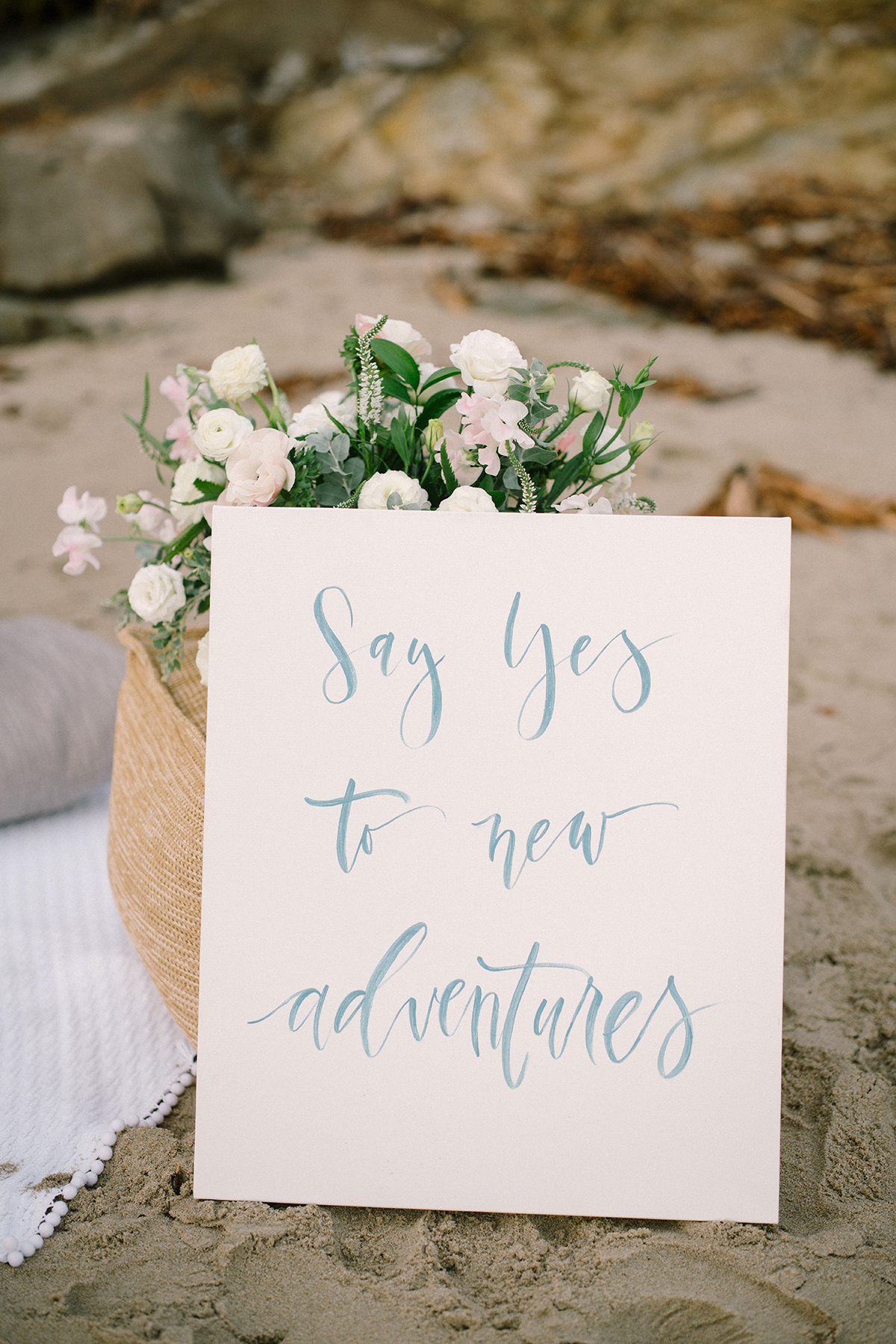photo booth travel prop card that reads Say yes to new adventures
