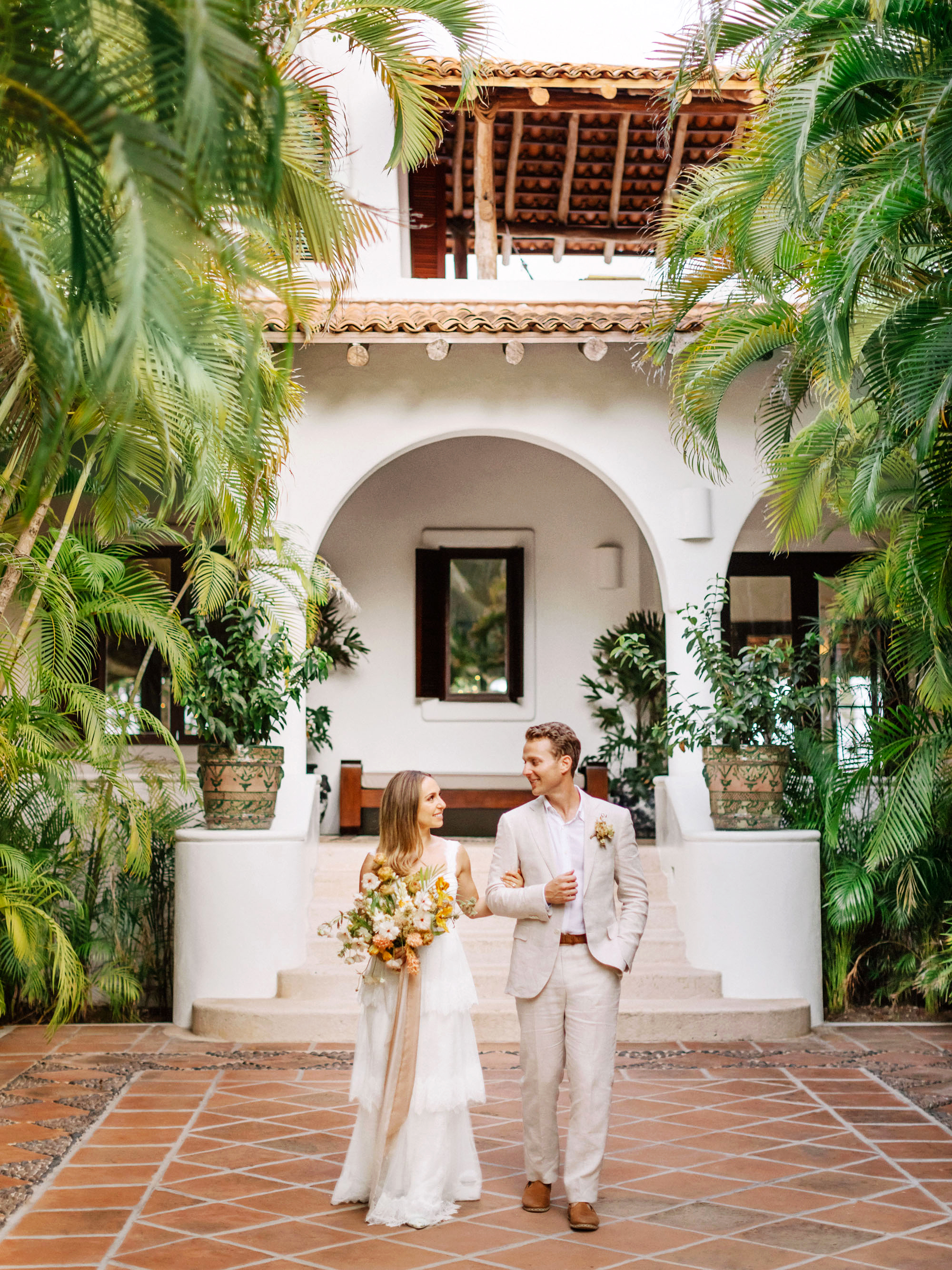 ariel trevor wedding tulum mexico couple walking