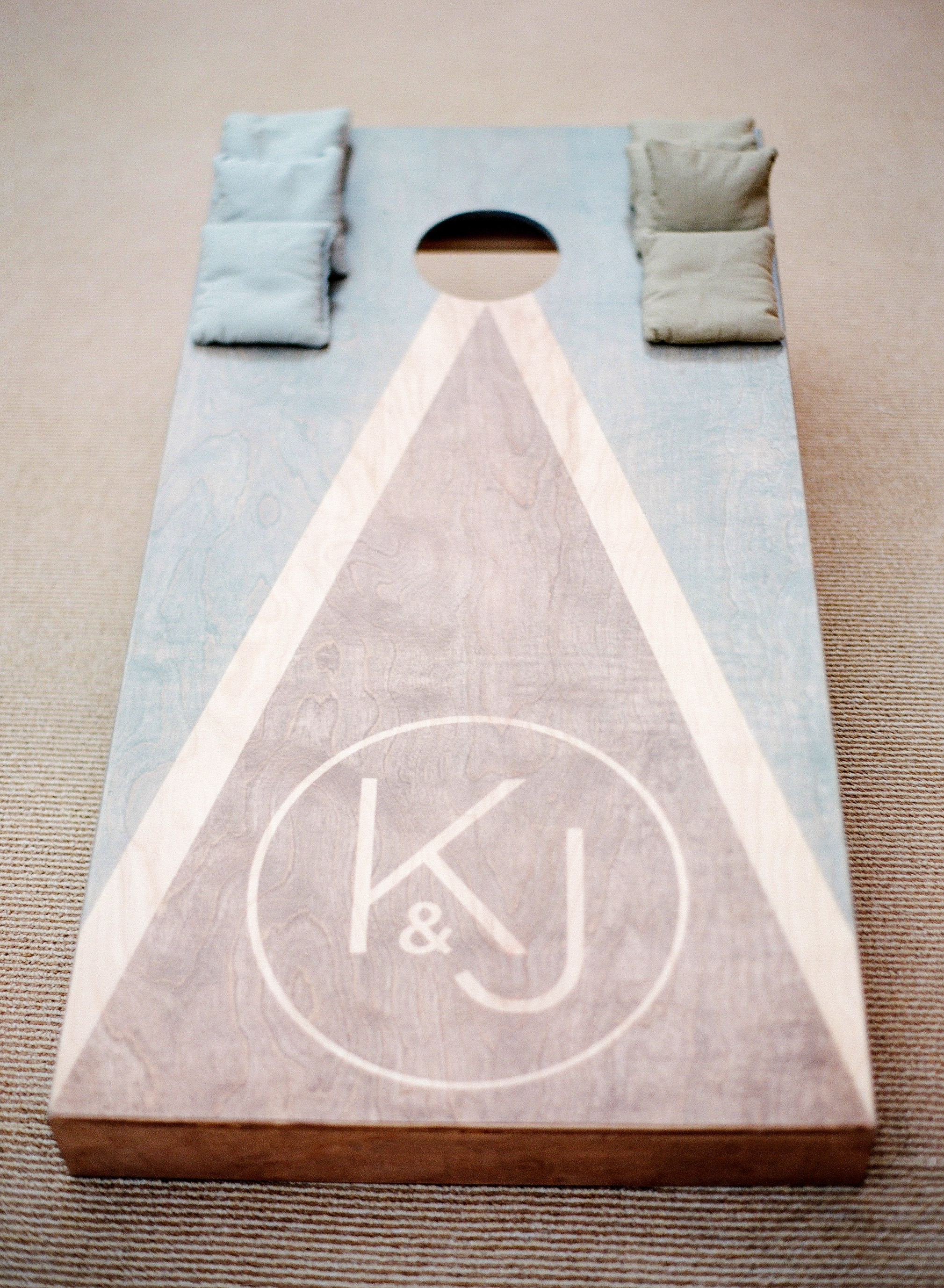kelsey joc wedding santa barbara california monogram cornhole