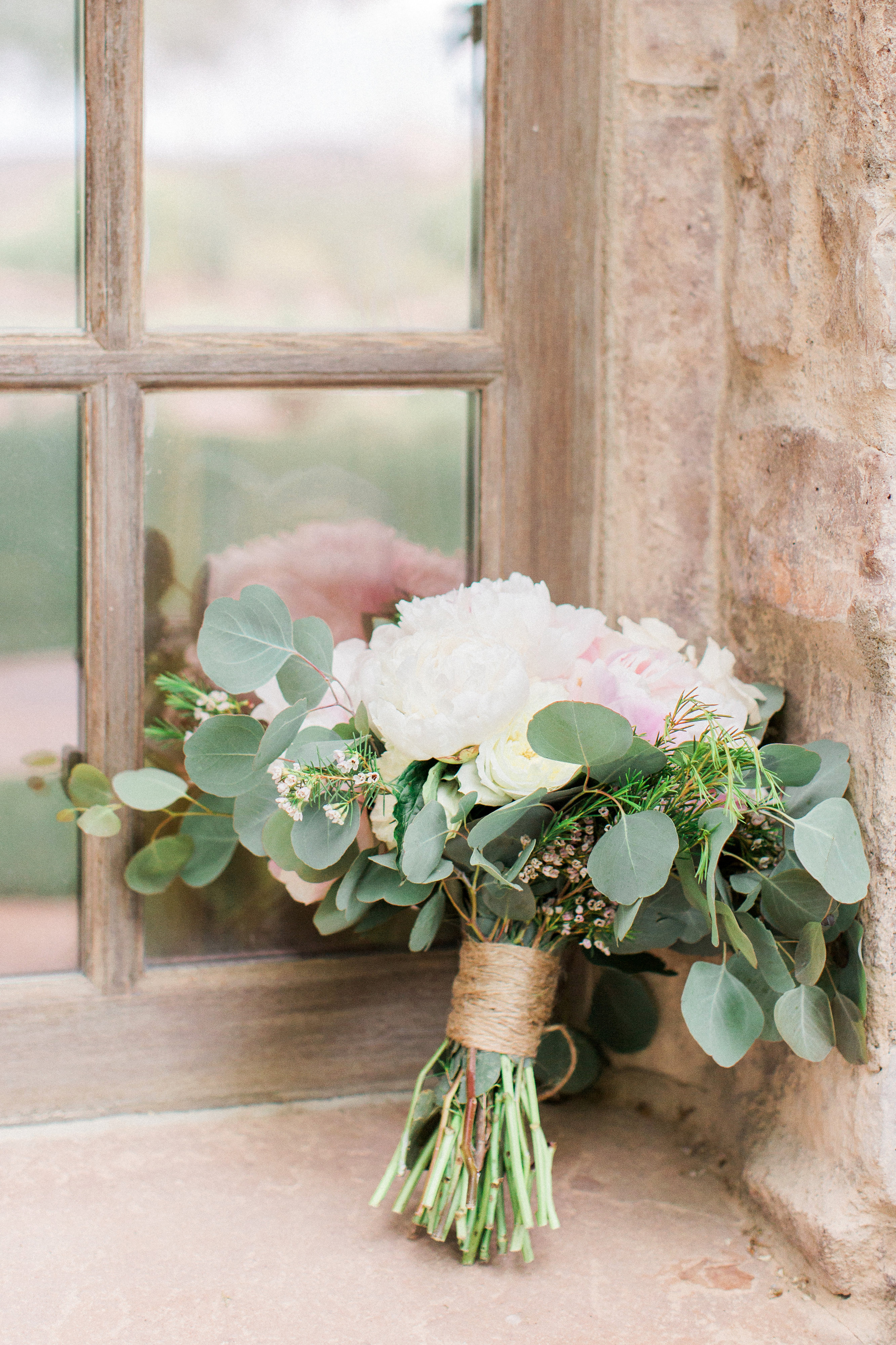 bouquet wraps flowers twine resting against window
