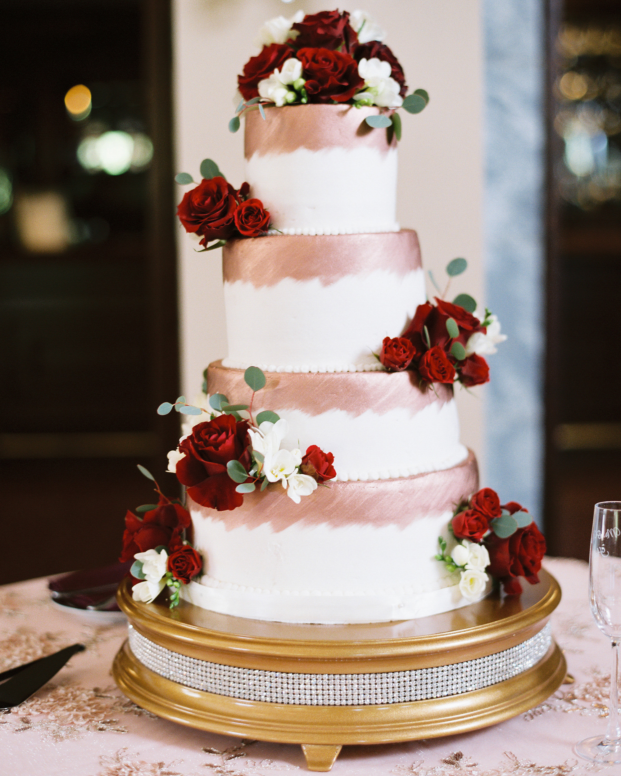 niara allen wedding cake gold with red roses