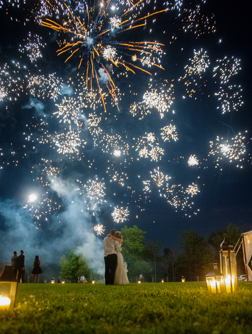 after party decor bride and groom beneath fireworks