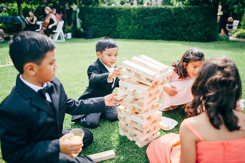 kids playing jenga at wedding