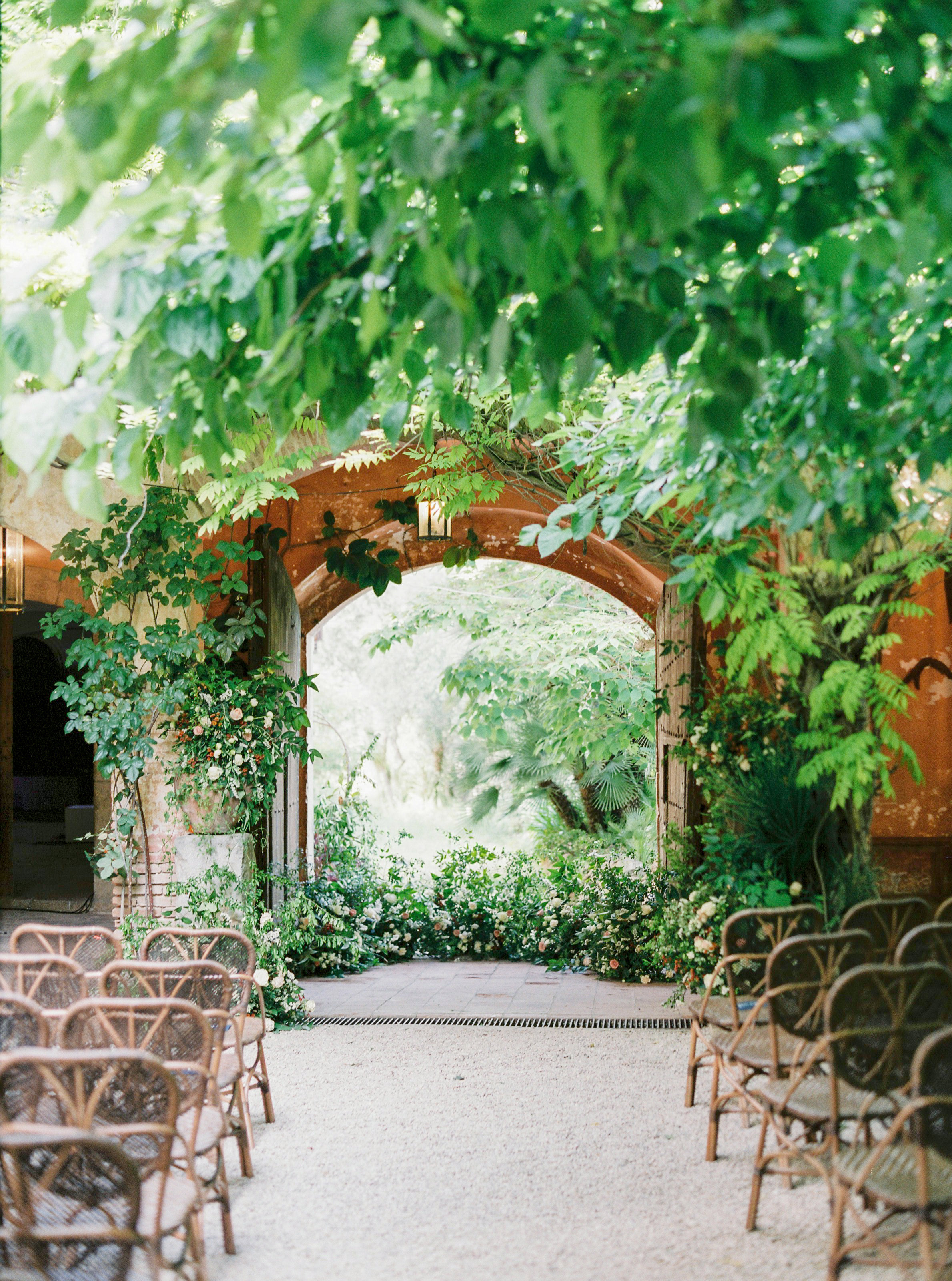 wedding ceremony outdoor location with floor mounted flowers