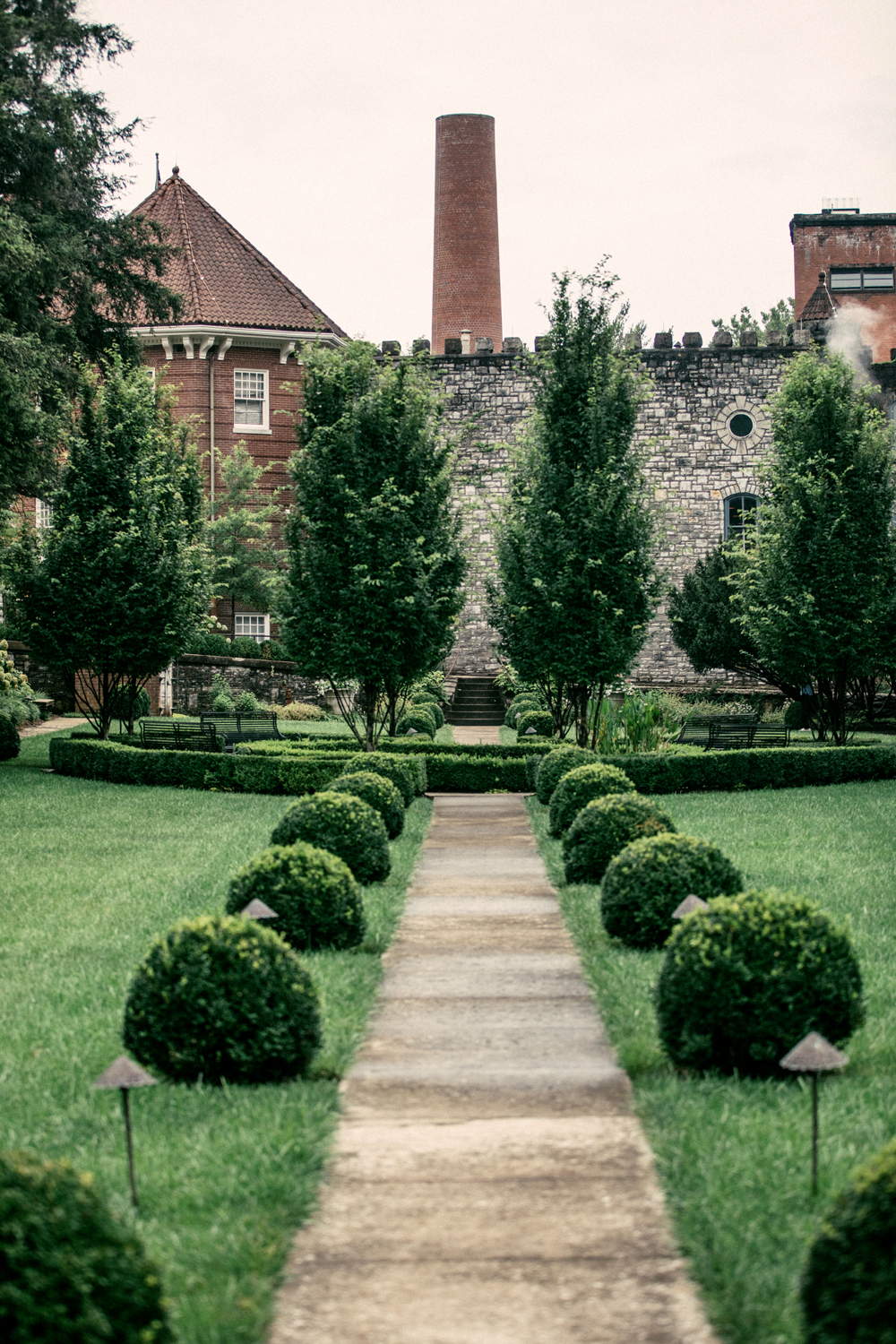 entrance to castle and key distillery with greenery path