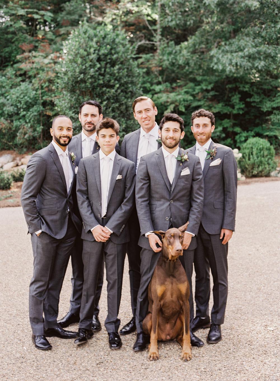 beth aaron wedding groomsmen with doberman