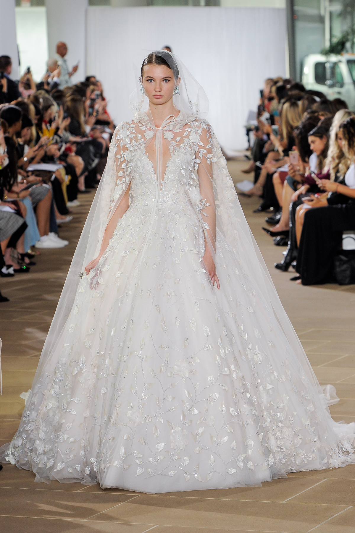 ines di santo fall 2019 deep v-neck ball gown with sheer hooded cape