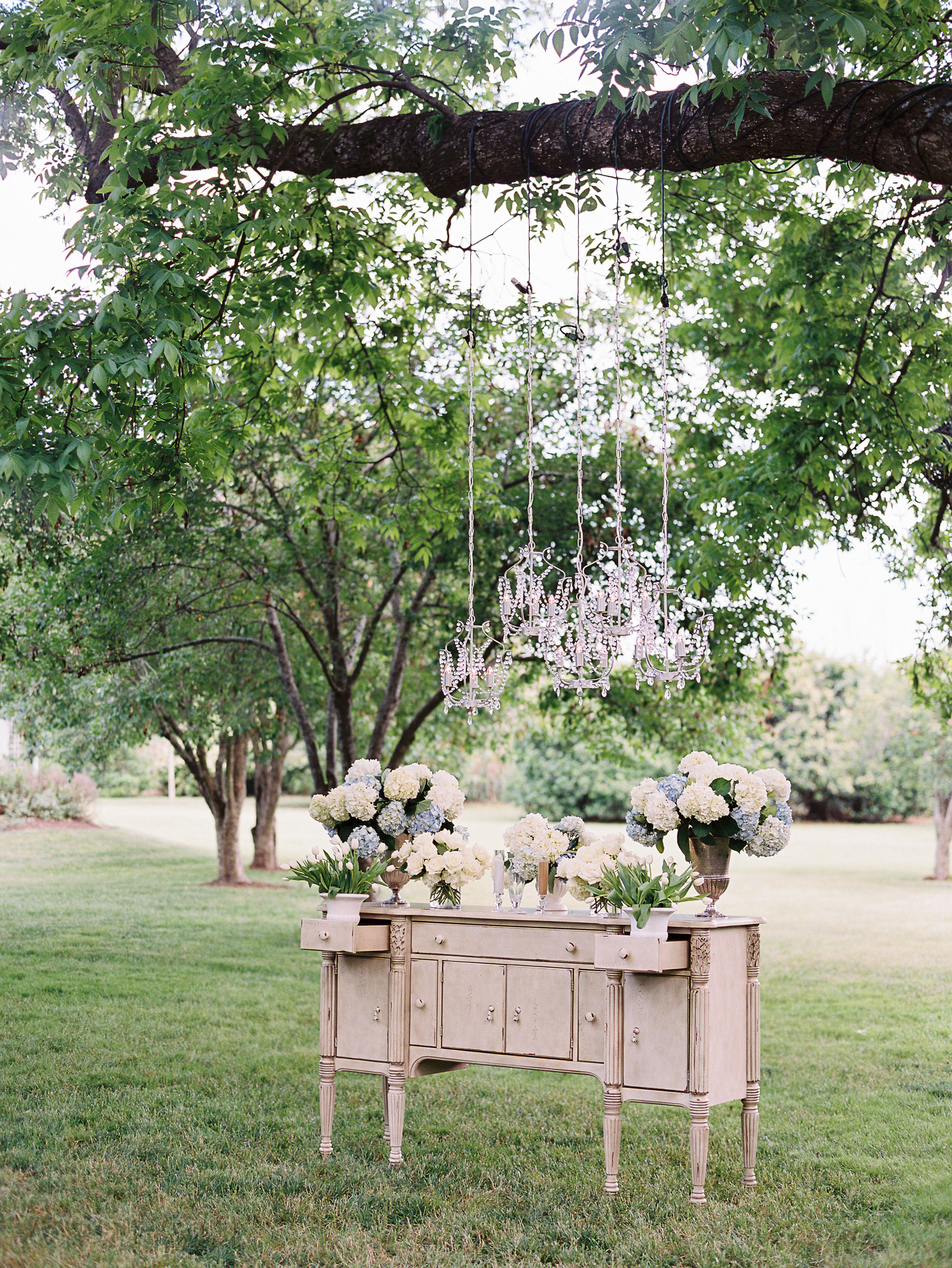 wedding chandelier outdoor suspended above antique furniture