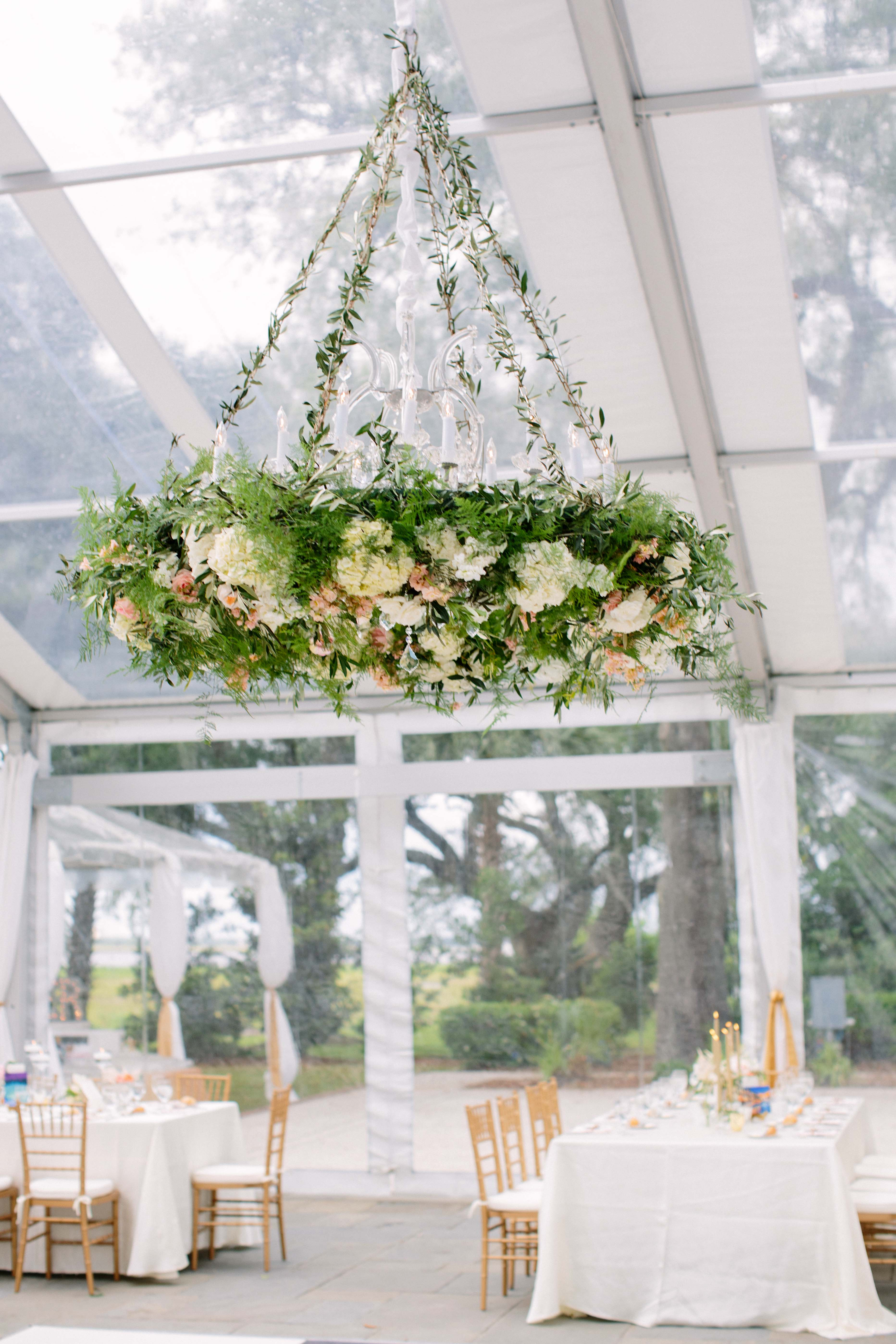 wedding chandelier greenery with white and pink flowers with classic lights