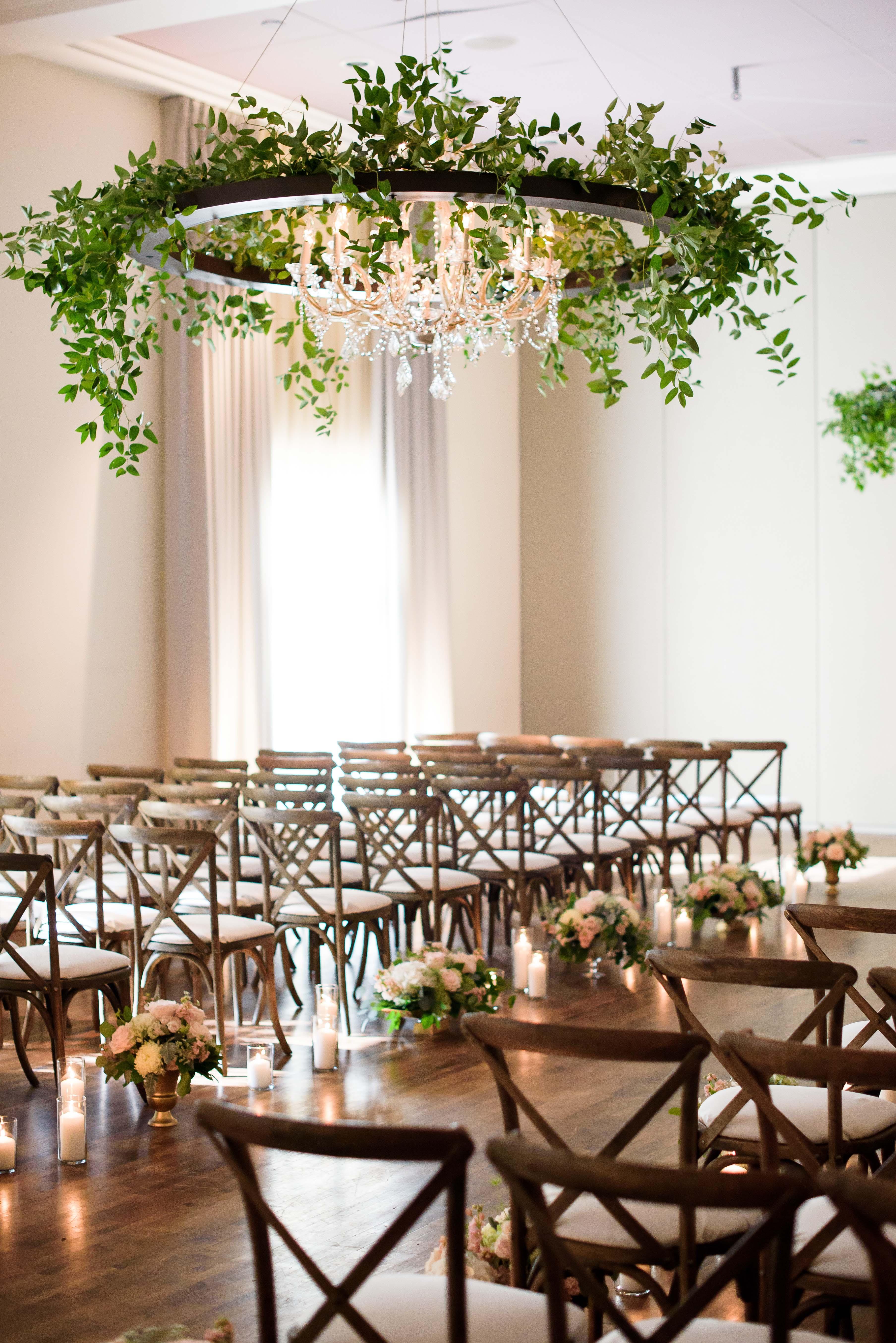 wedding chandelier sleek black circle with greenery