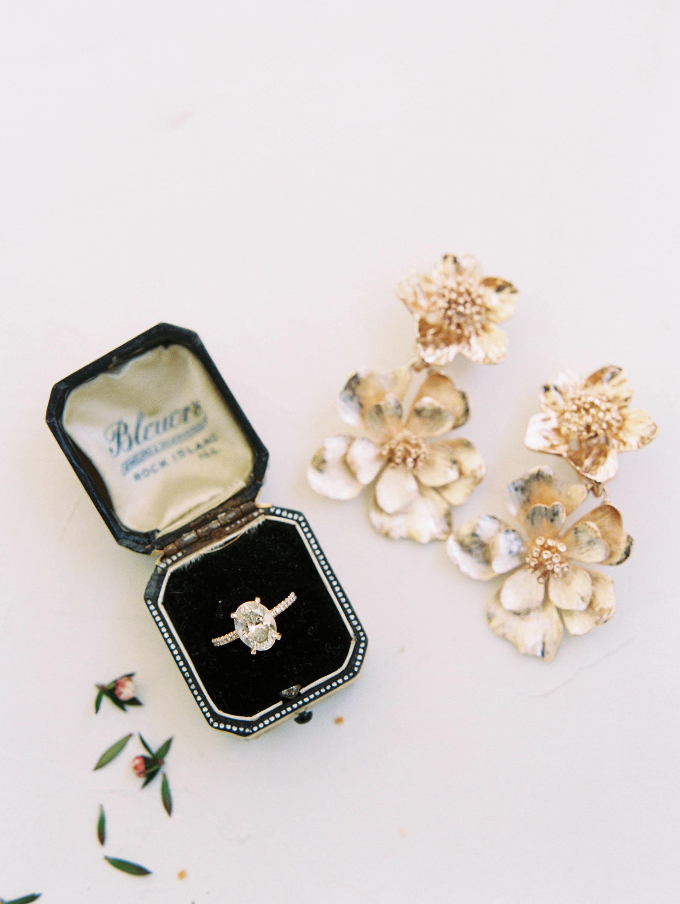 wedding ring jewelry and floral earrings