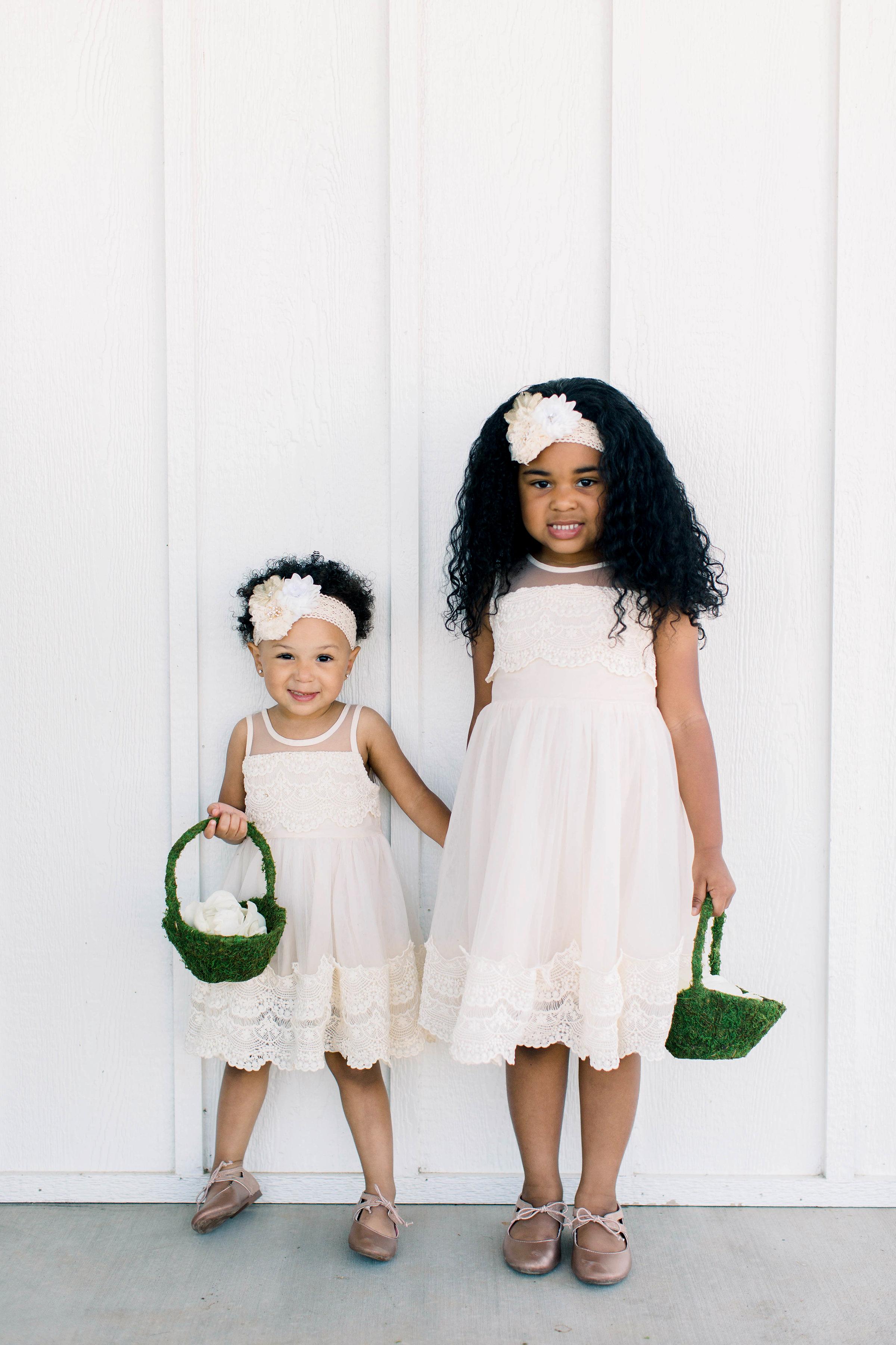 wedding flower girls carrying green baskets