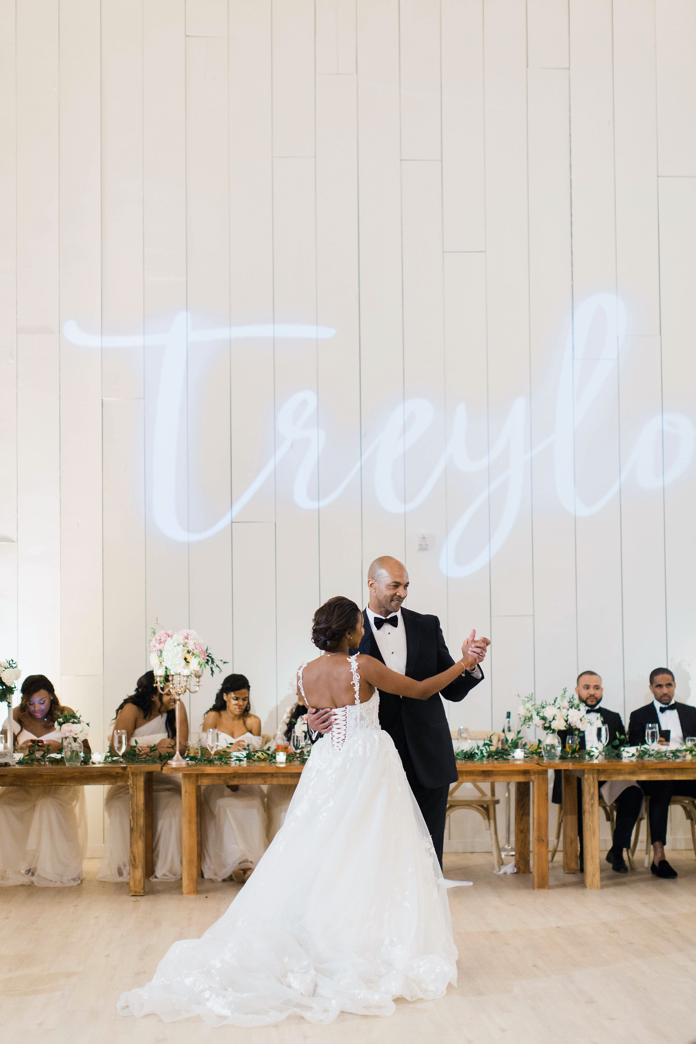 wedding reception father daughter dance name on wall