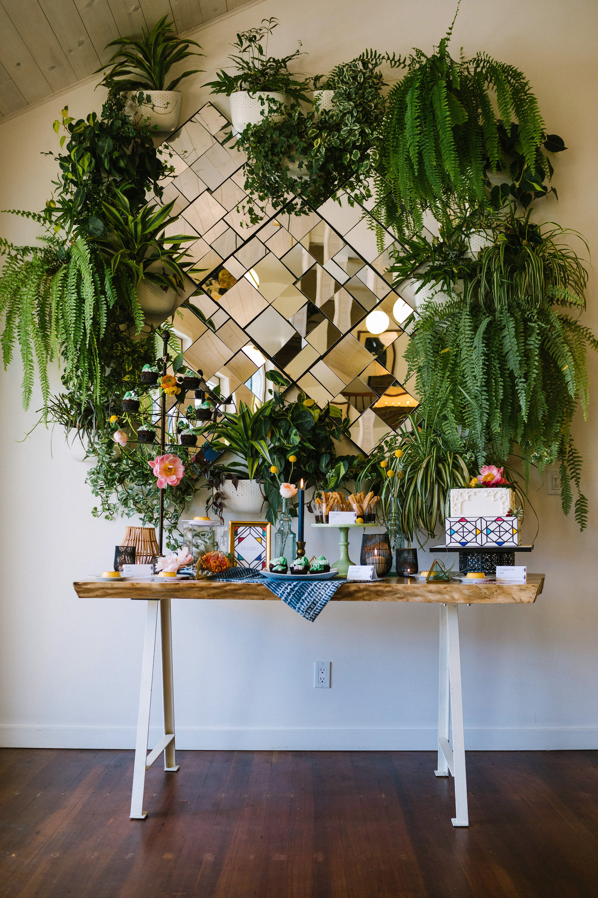 built in mirror backdrop with various plants treat table