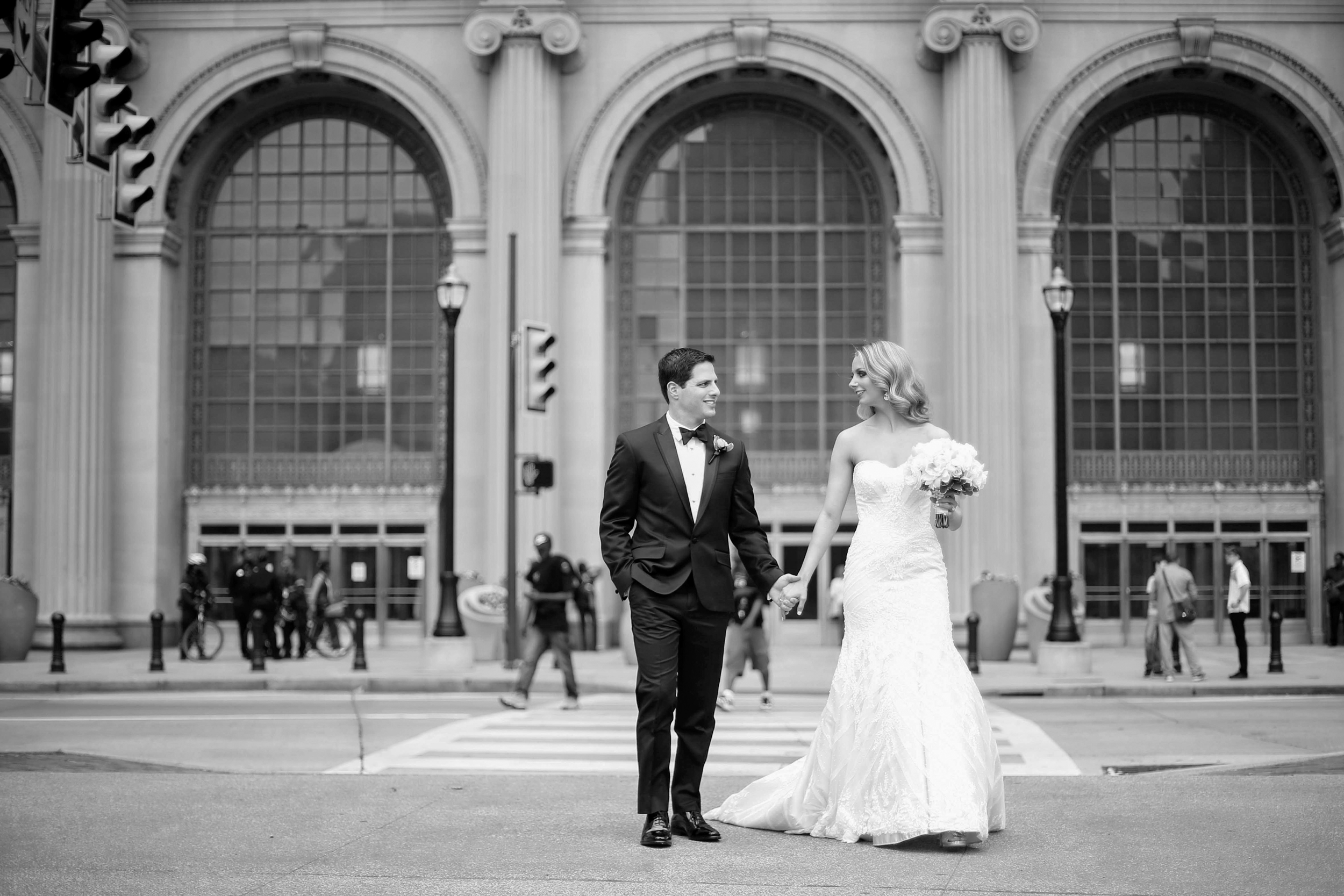 city hall wedding bride and groom holding hands outside of building