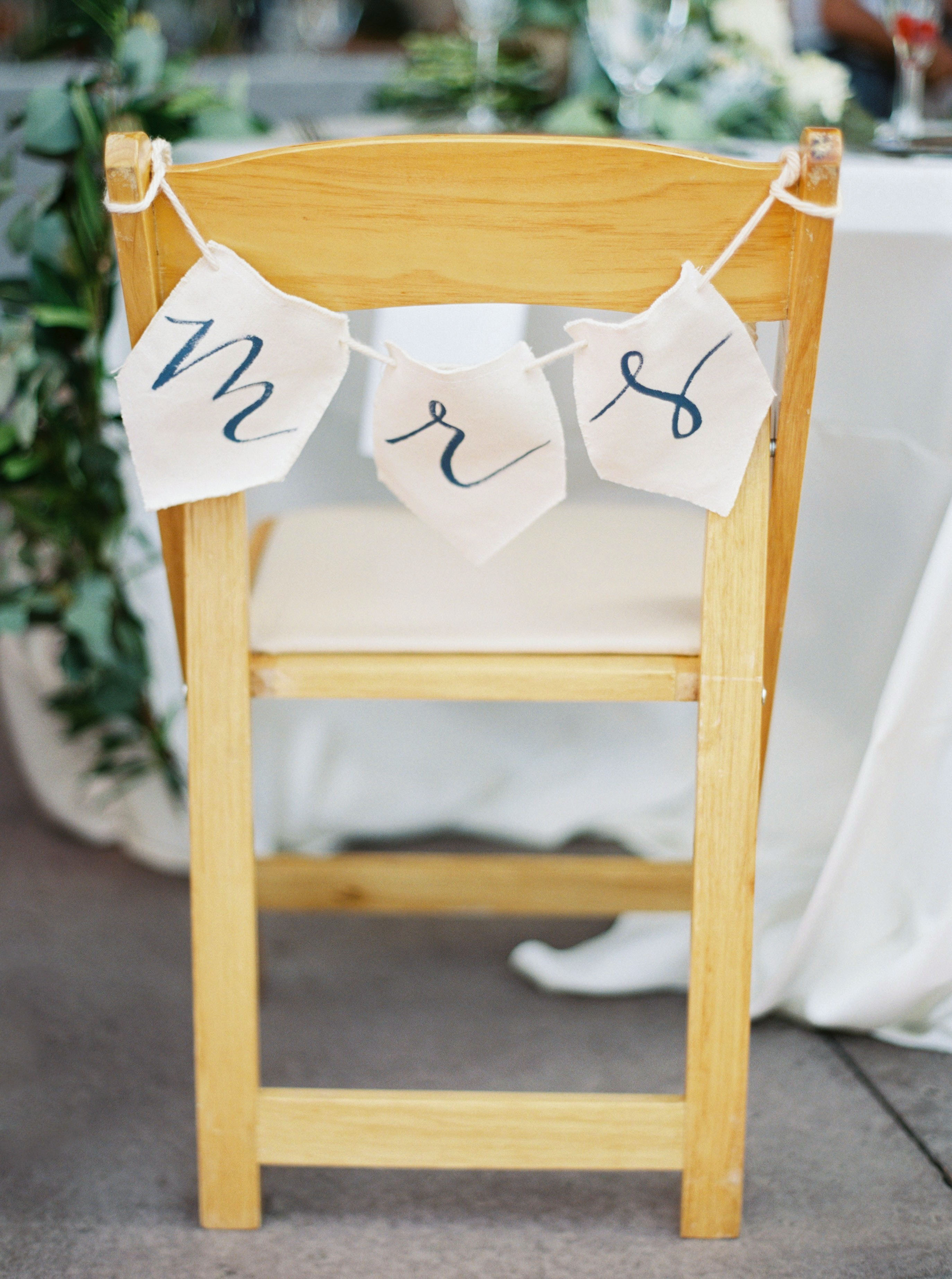 mrs sign pennants cursive letters on a rope