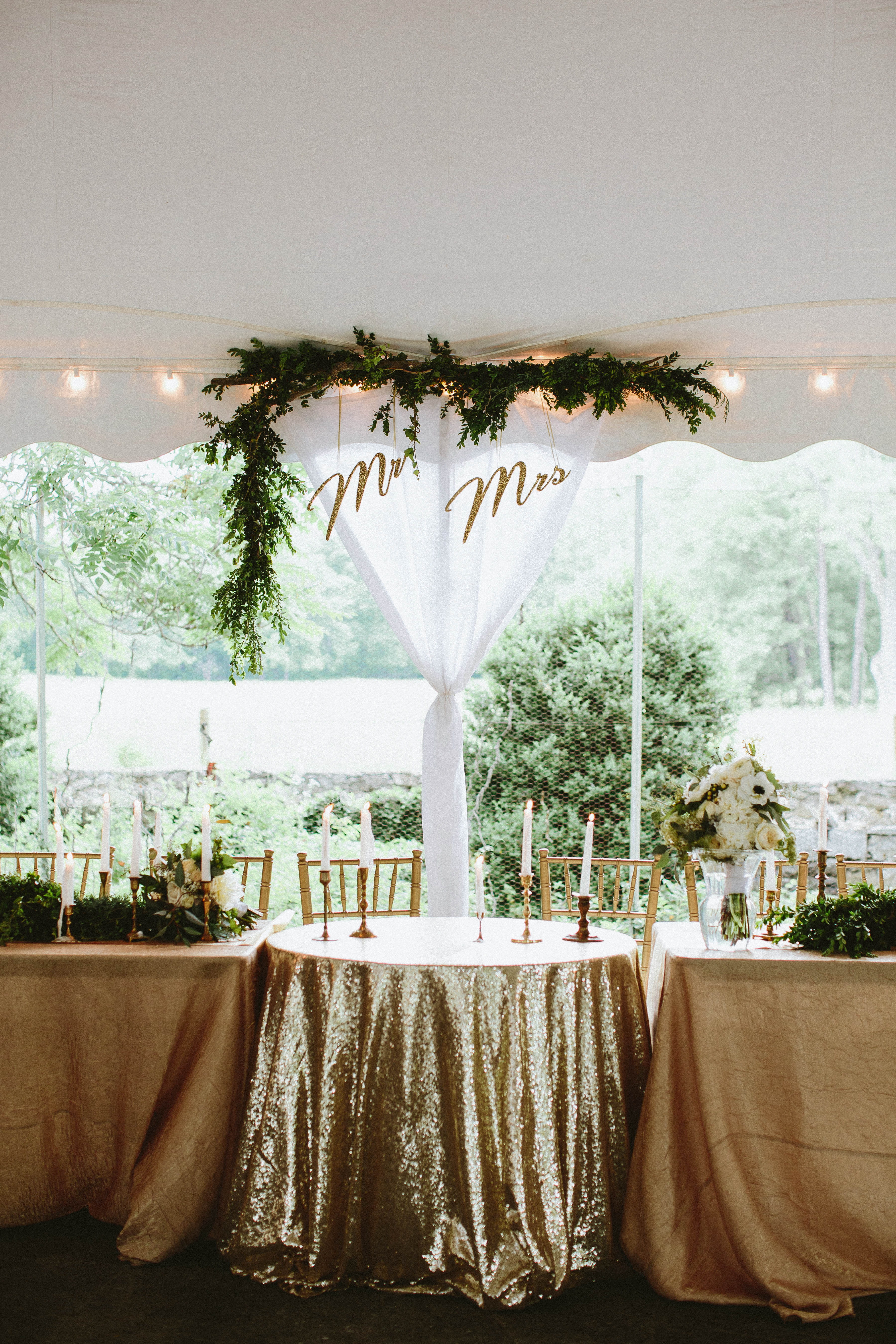 mr and mrs suspended cursive signs above sweetheart table