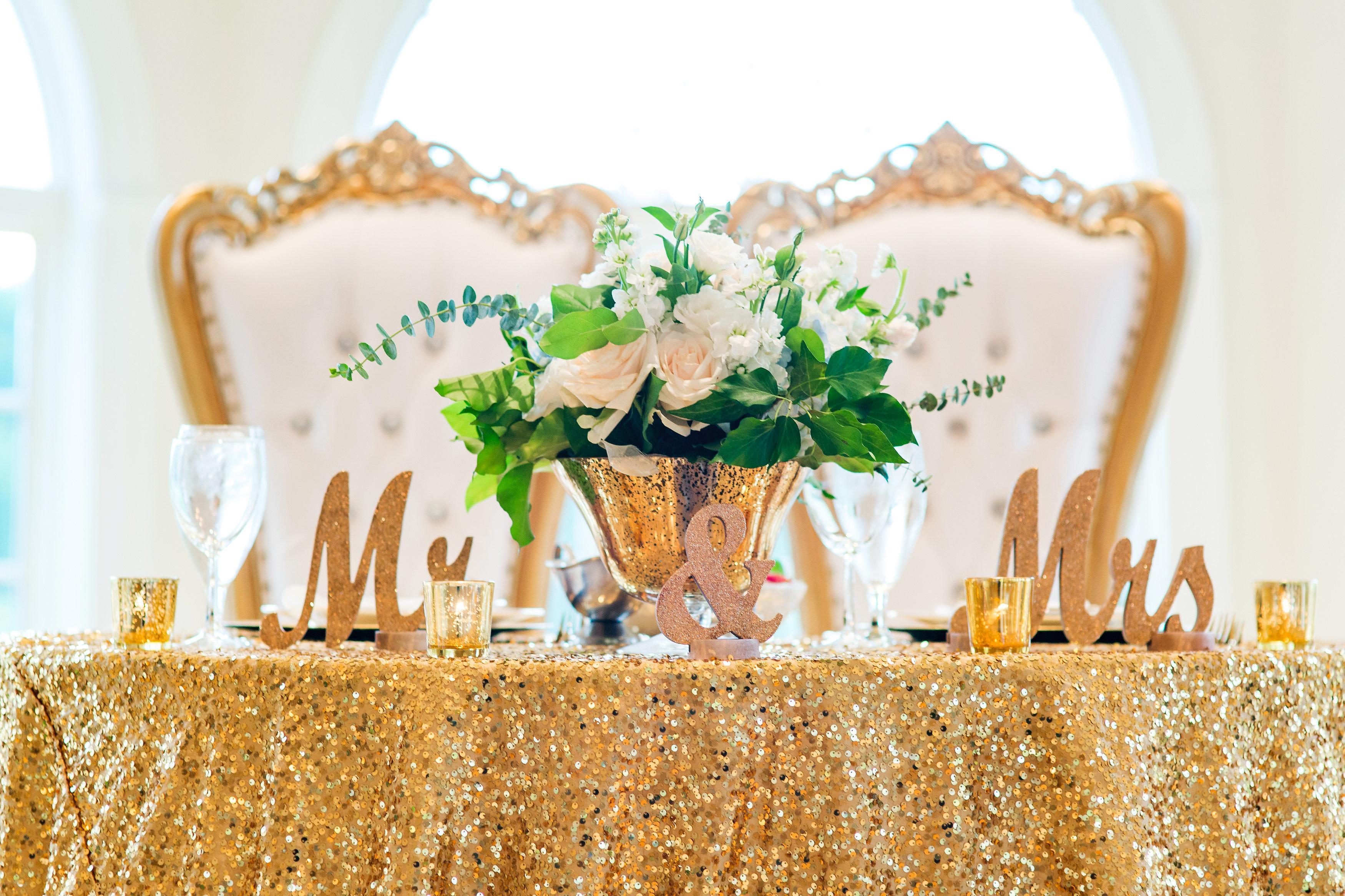 kenisha wendall wedding sweetheart table flowers Mrs. Mr.