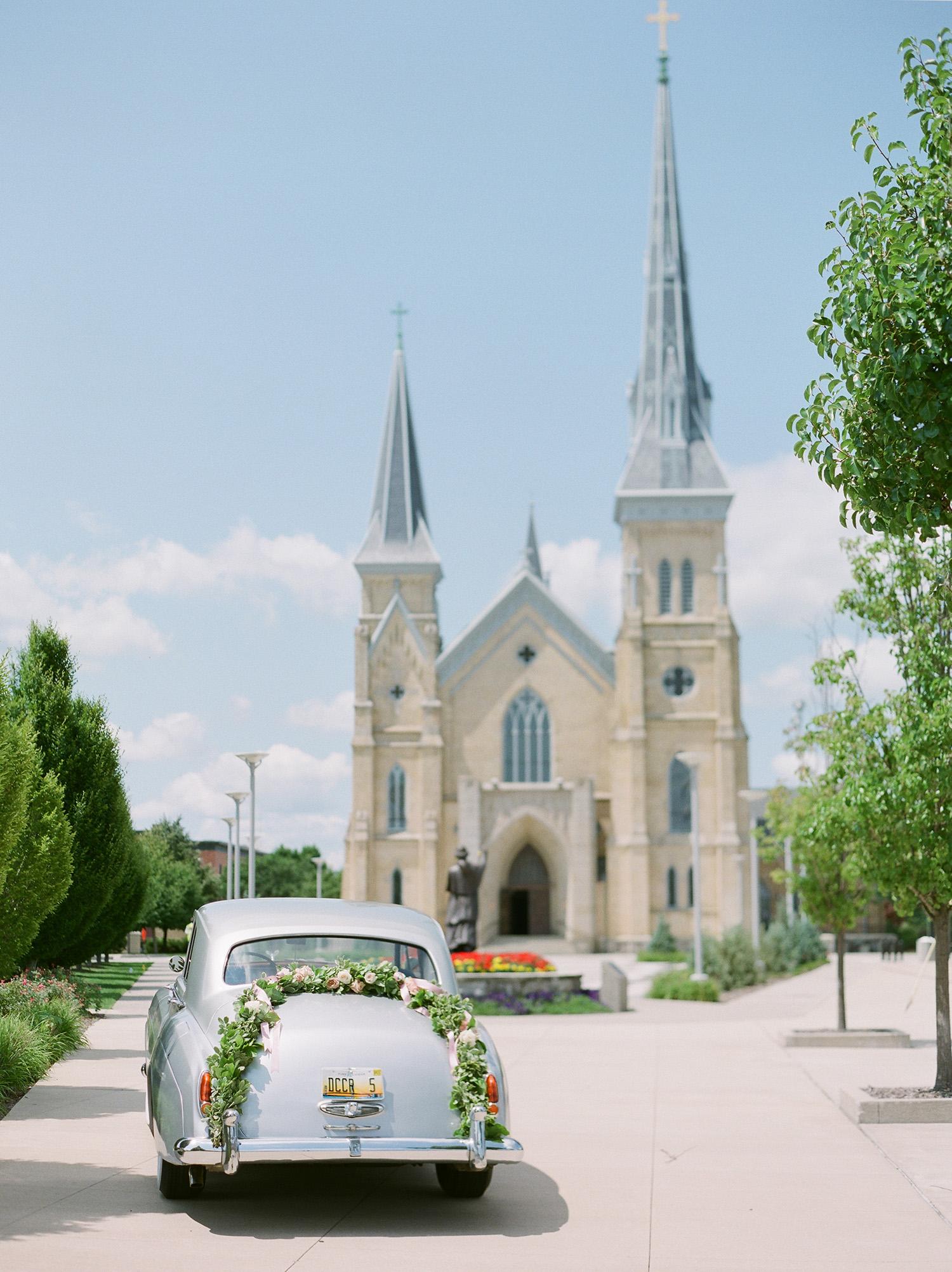 anwuli patrick wedding vintage car in front of church