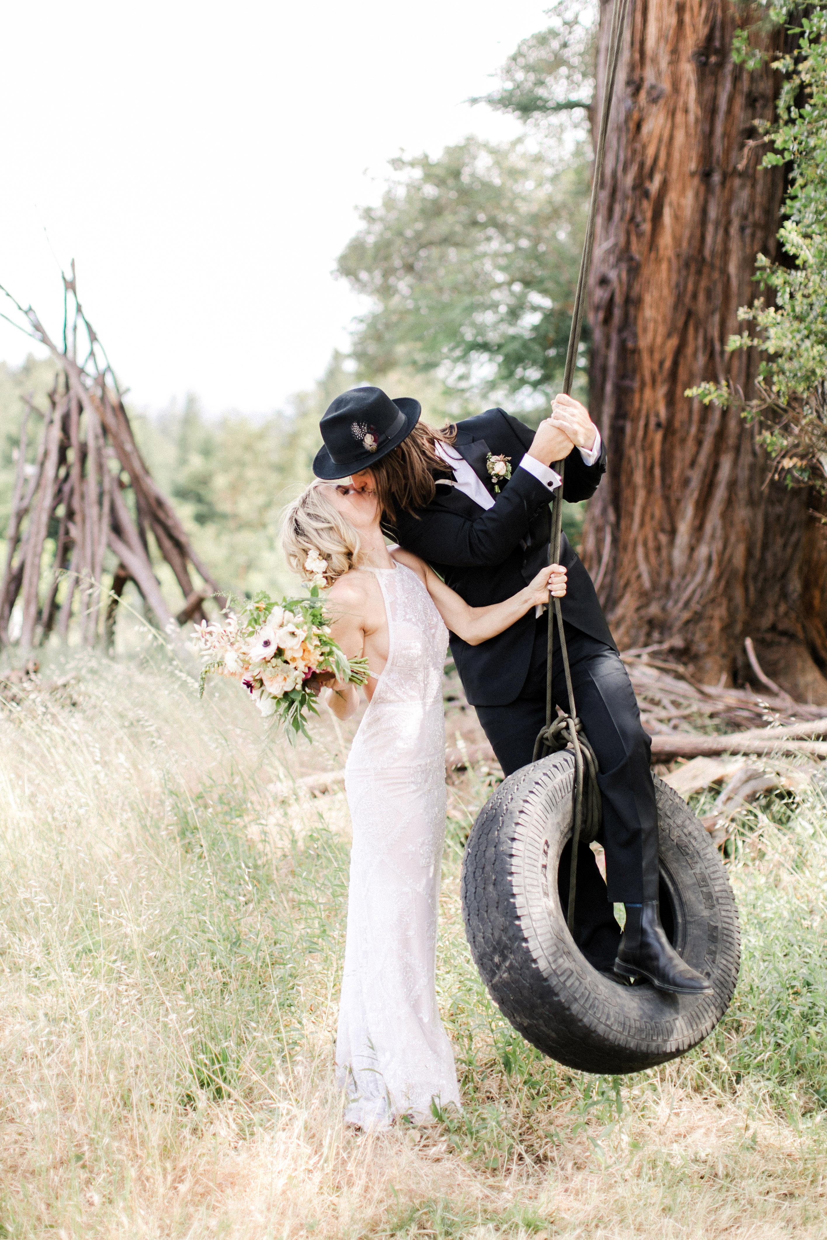 amanda chase wedding couple kissing on tire swing