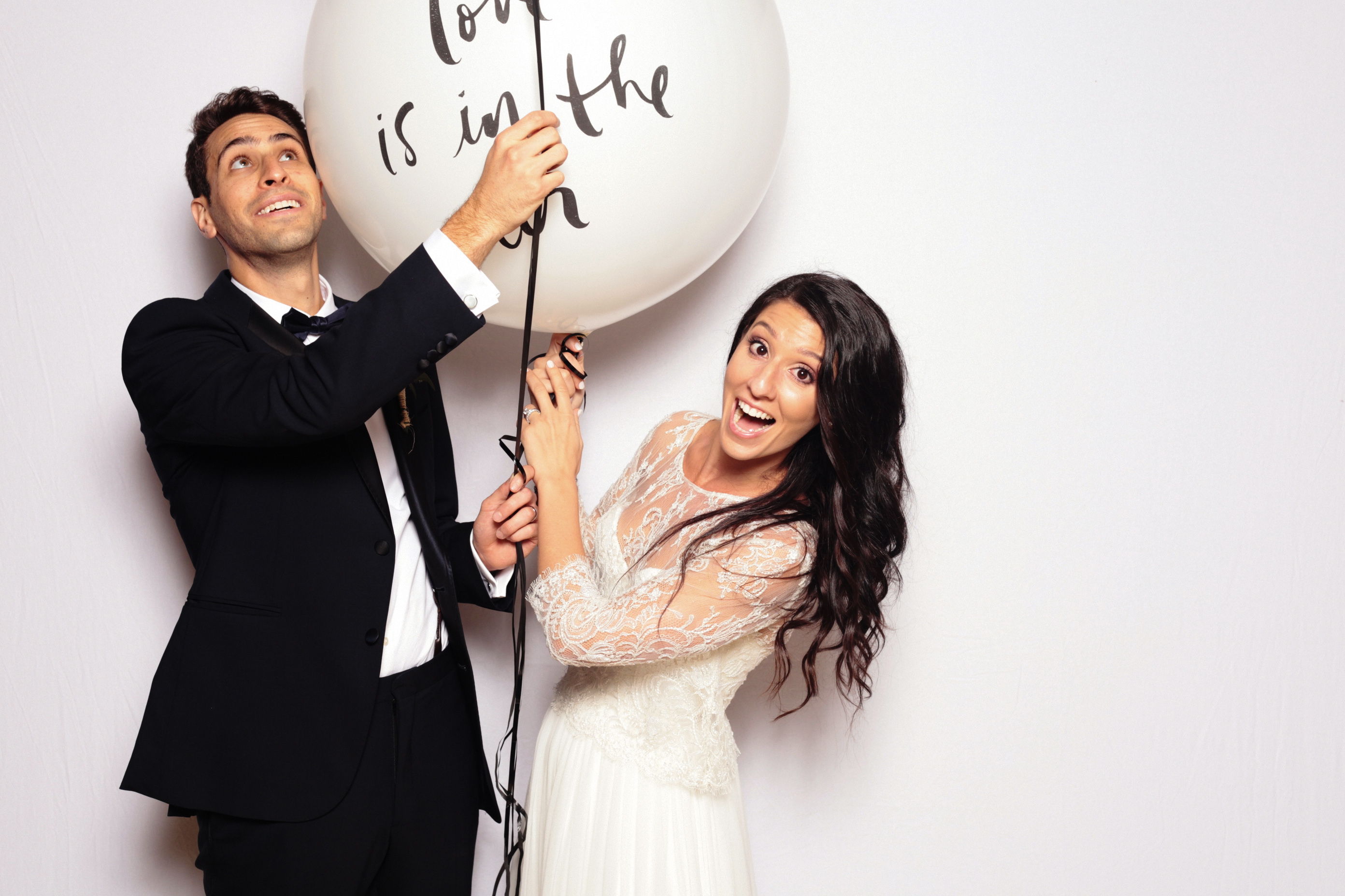 photo props couple large balloon with writing