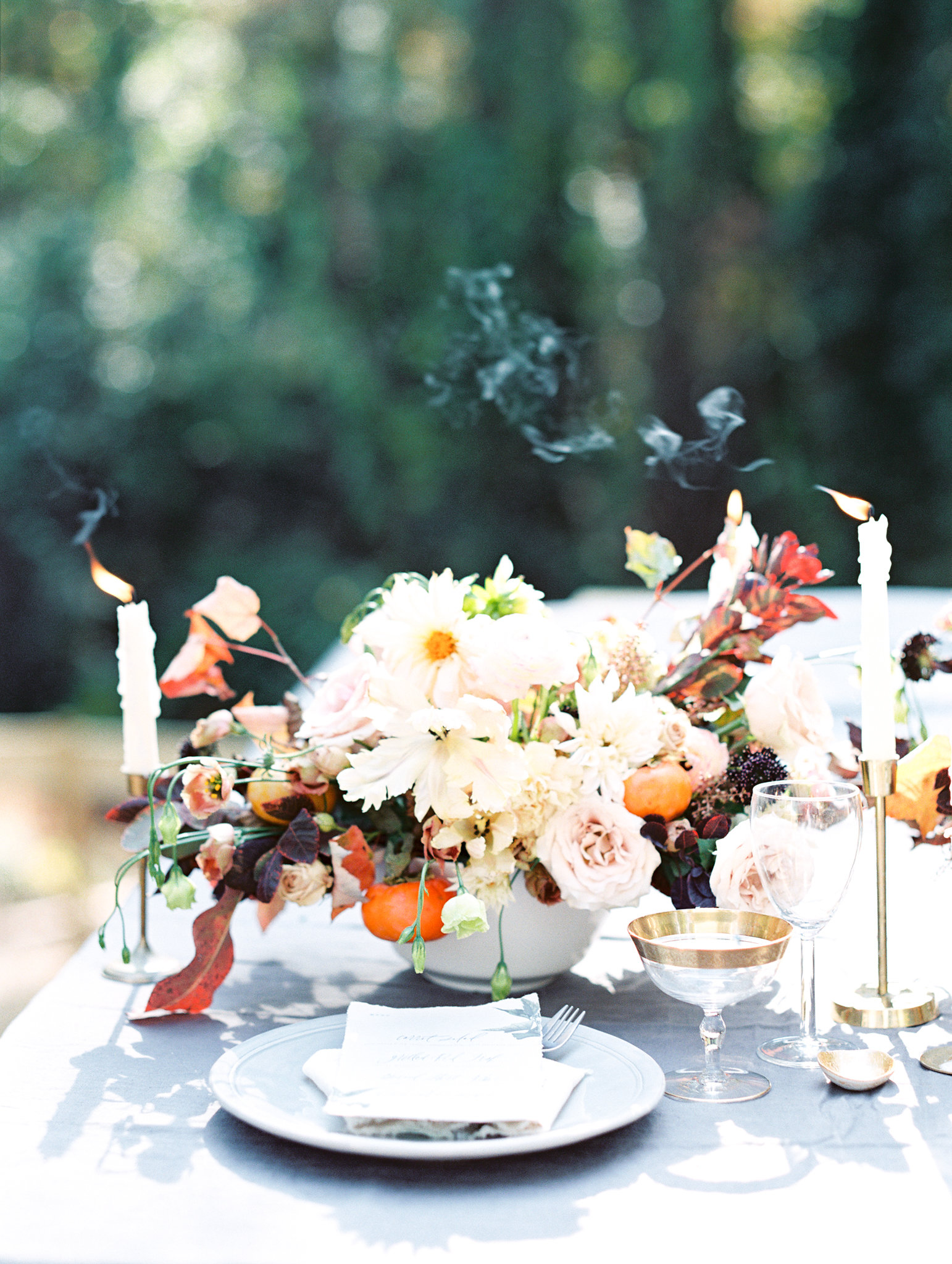 thanksgiving rehearsal dinner bold floral arrangement with candles