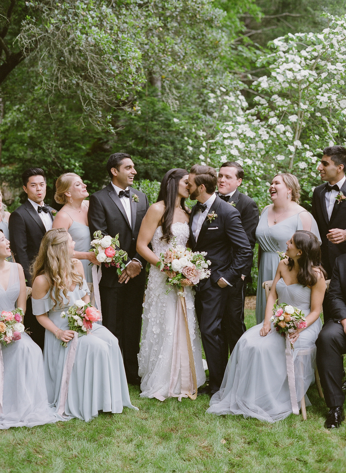 nadine dan wedding couple kiss surrounded by wedding party