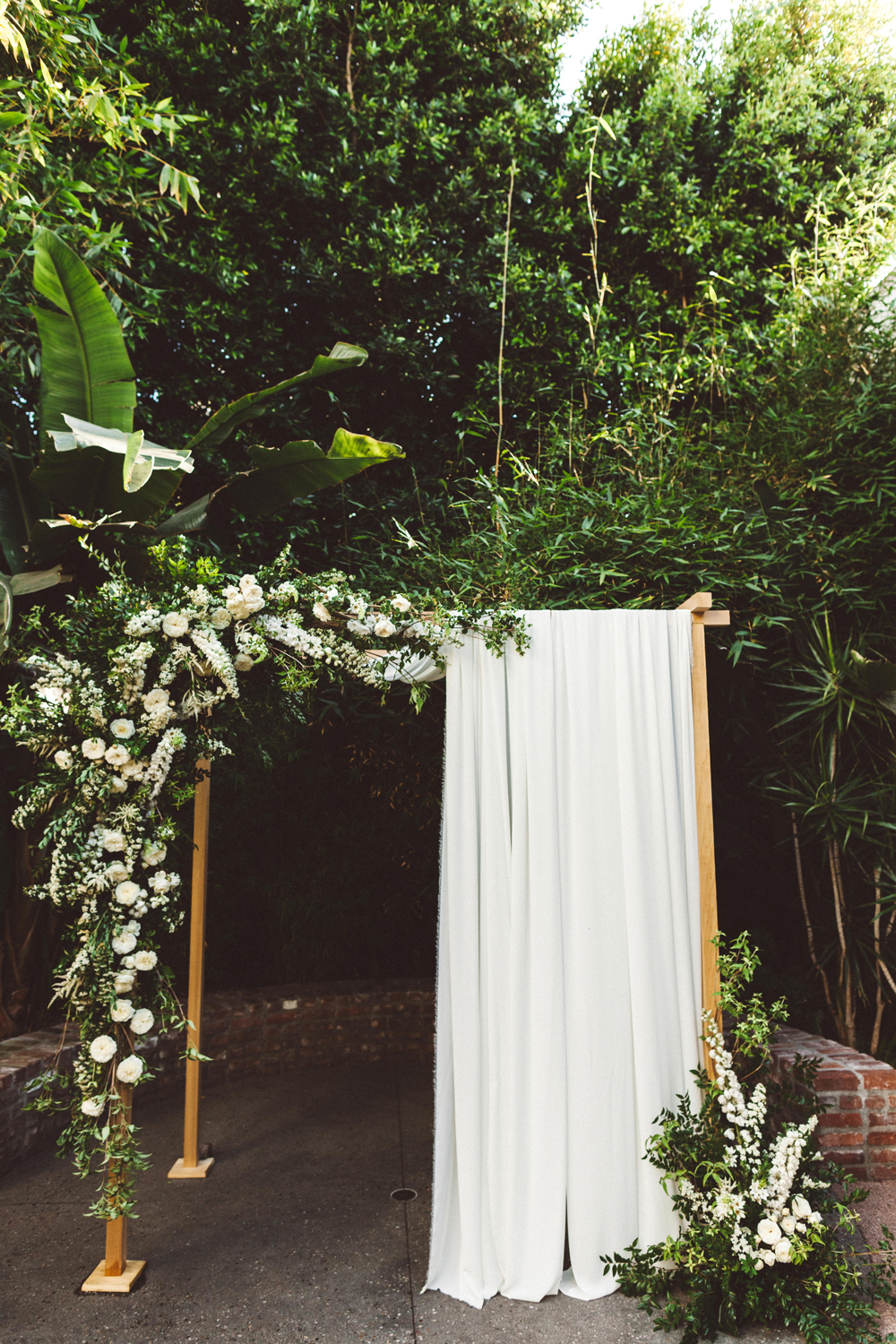 kaily matt wedding los angeles chuppah with white drapes
