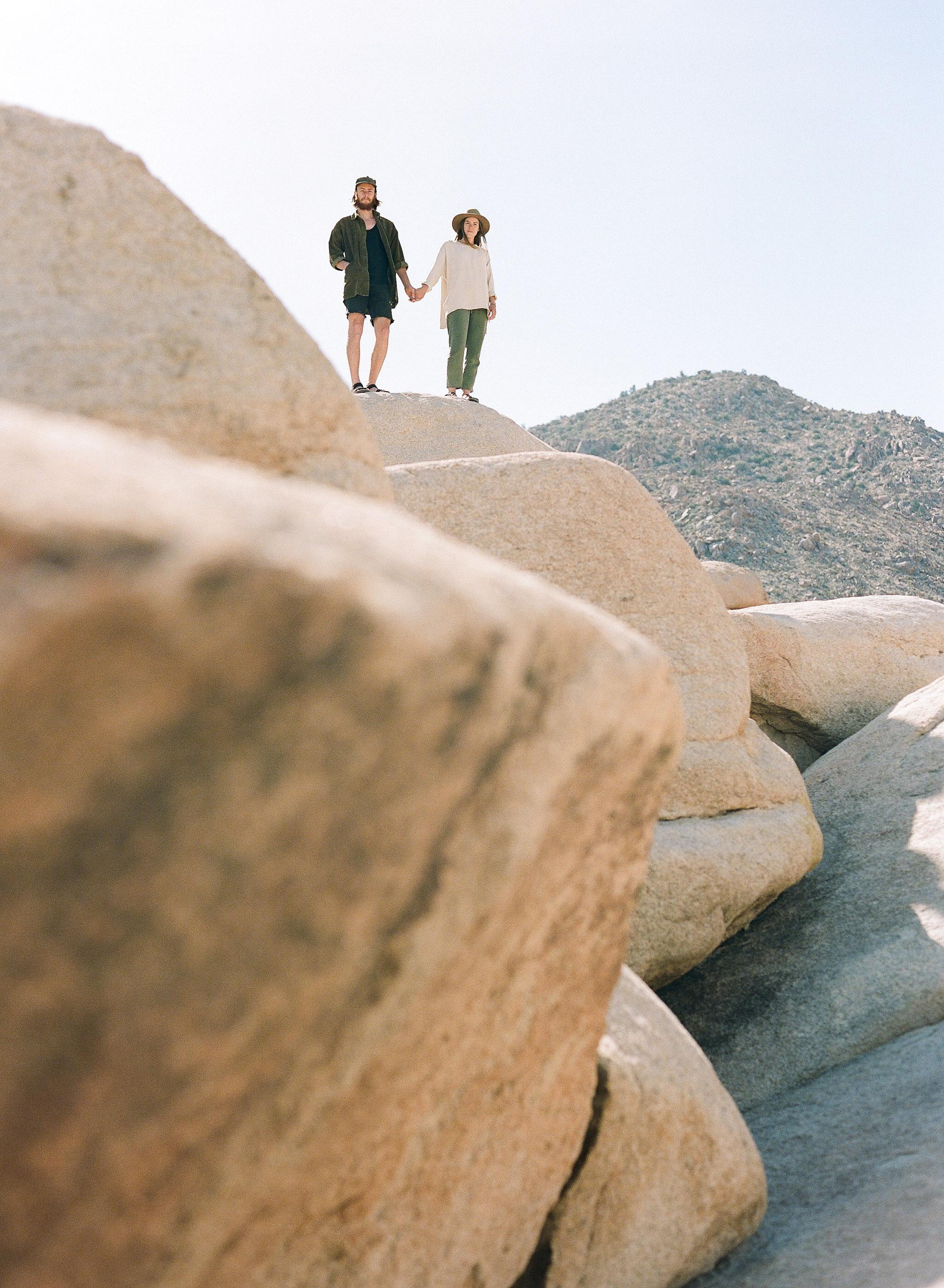 destination engagement couple dessert rock formations