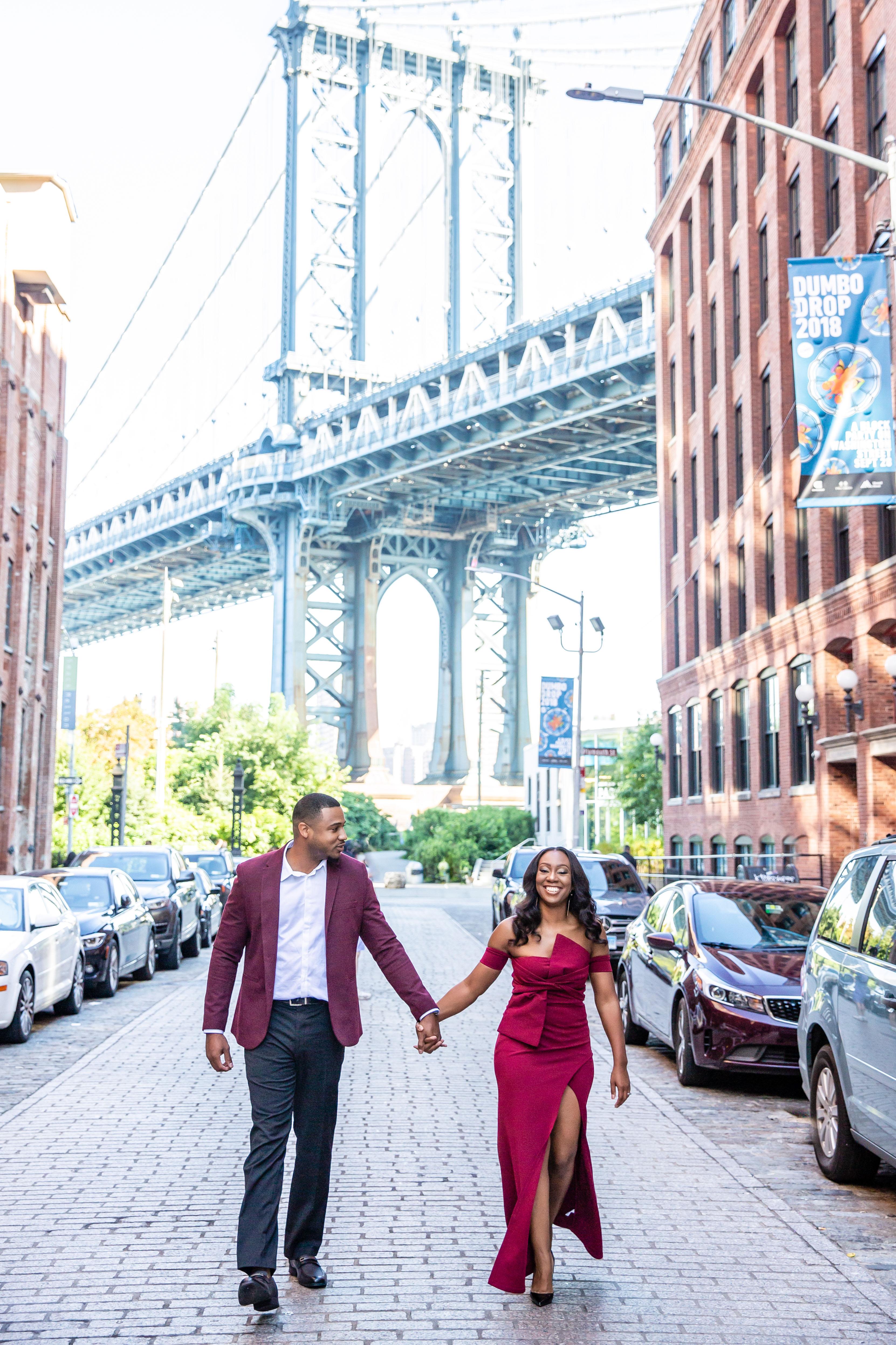 destination engagement couple Manhattan cobblestone streets