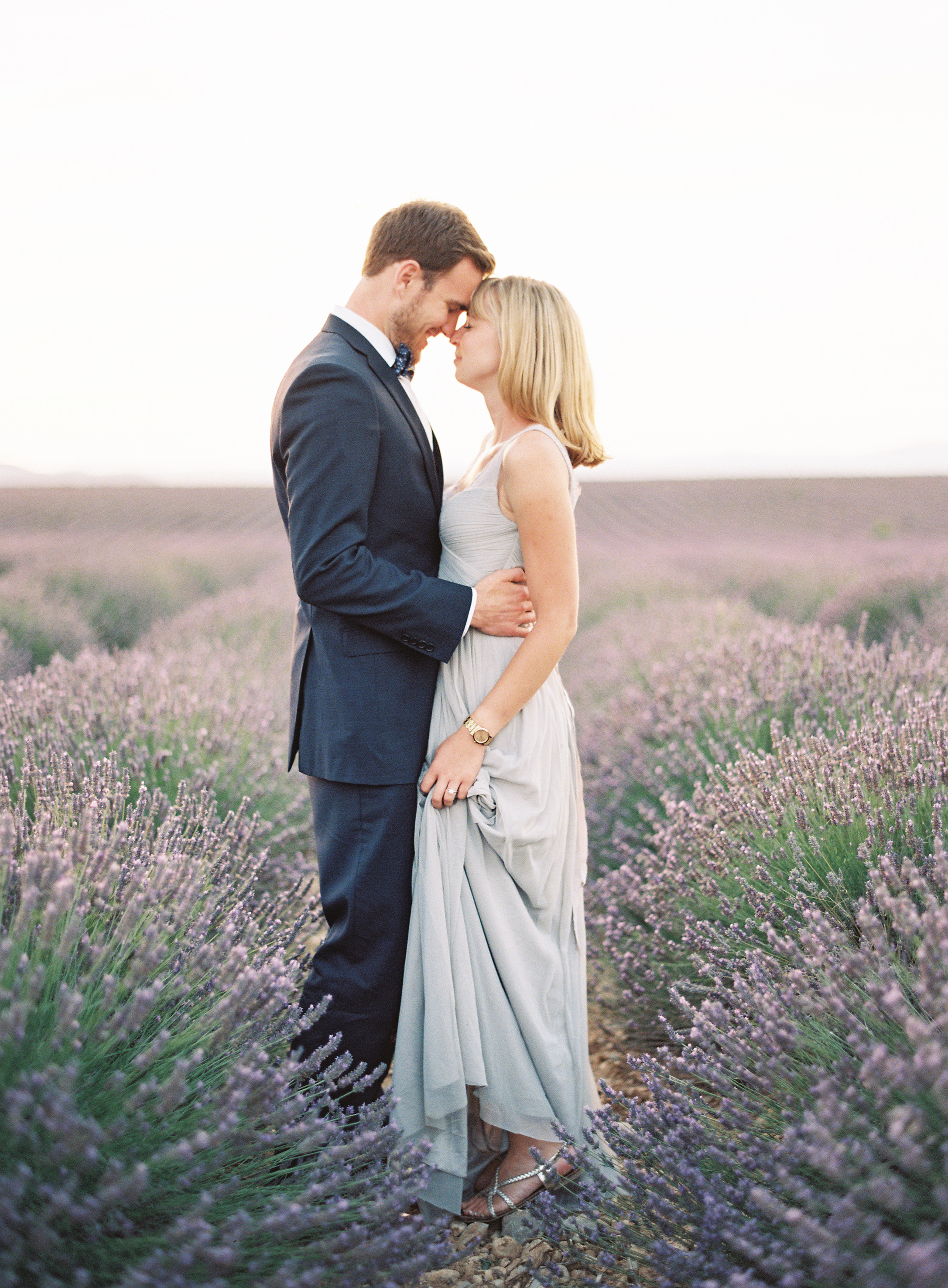destination engagement couple pose in lavender field france