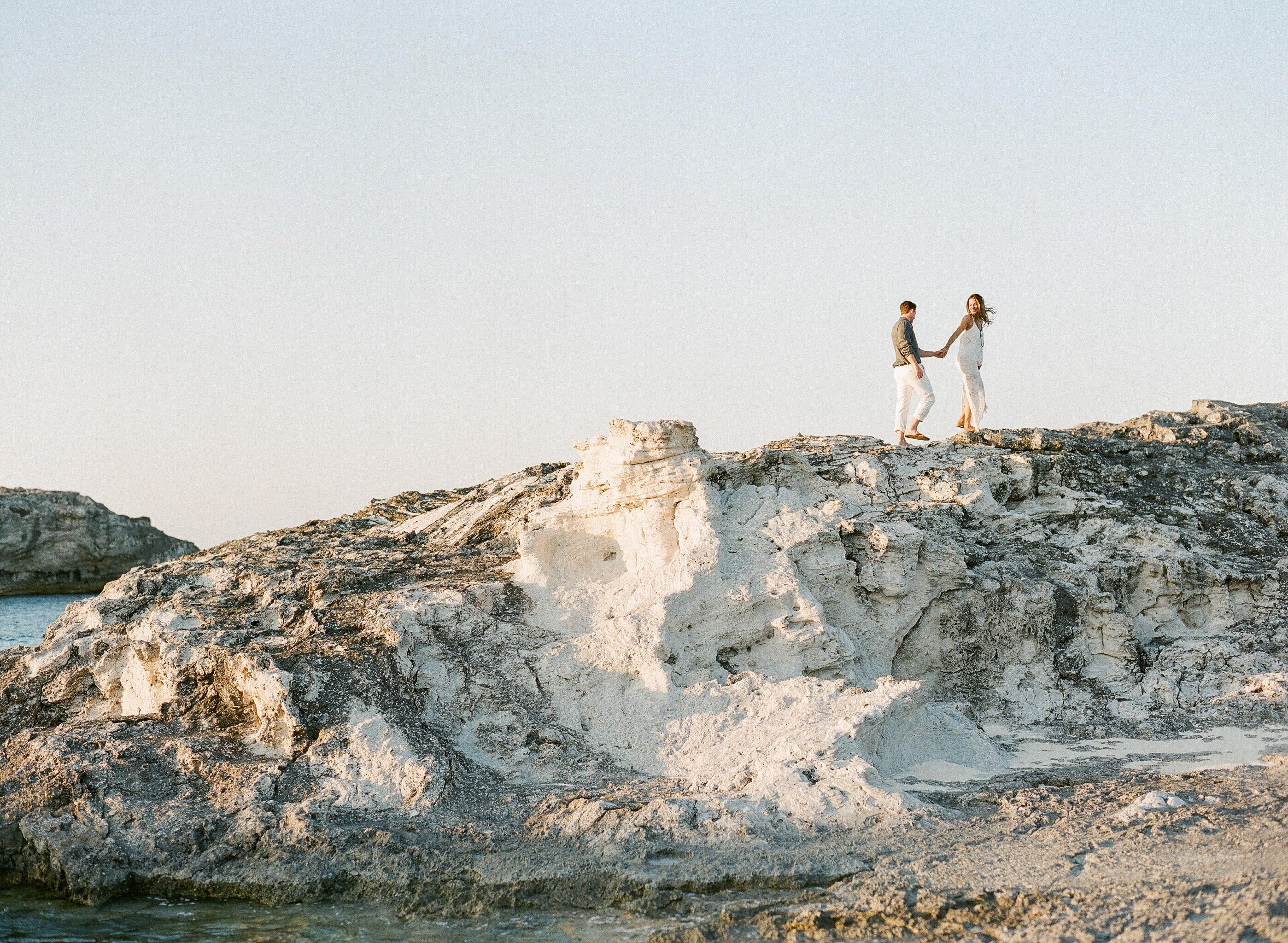 destination engagement couple high rocks on private island