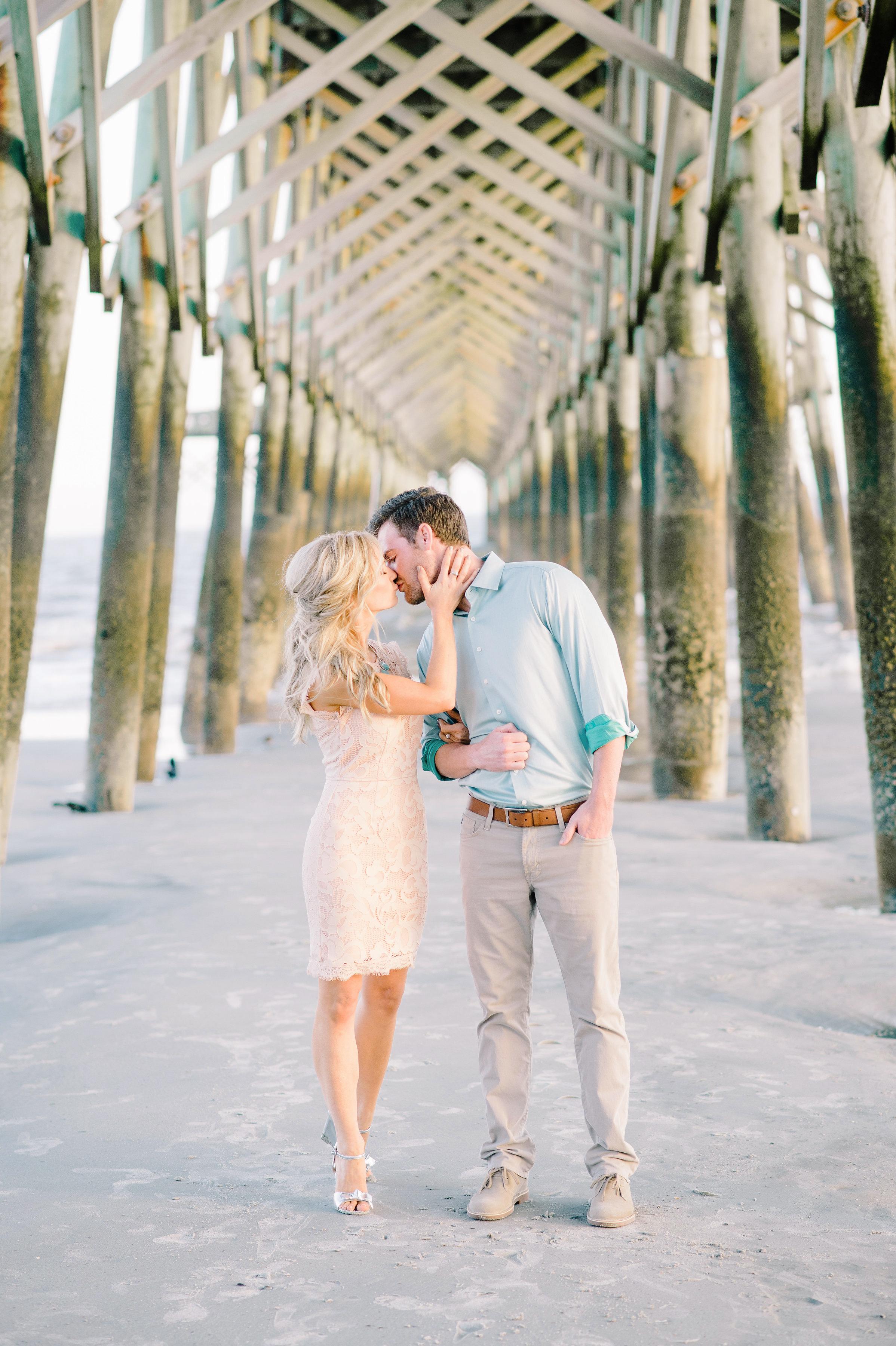 destination engagement under dock couple kiss