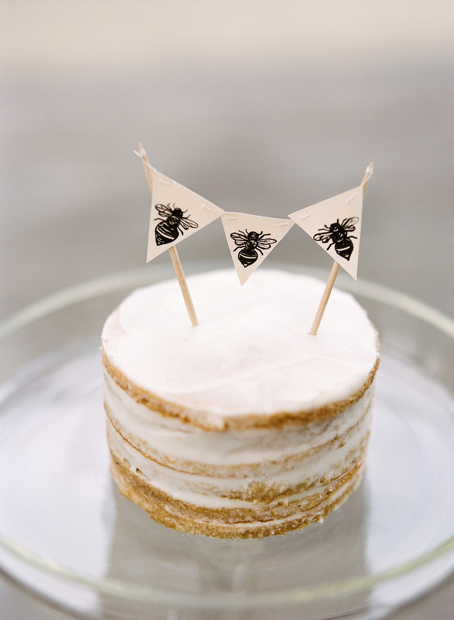 bee wedding ideas small naked cake with bee banner
