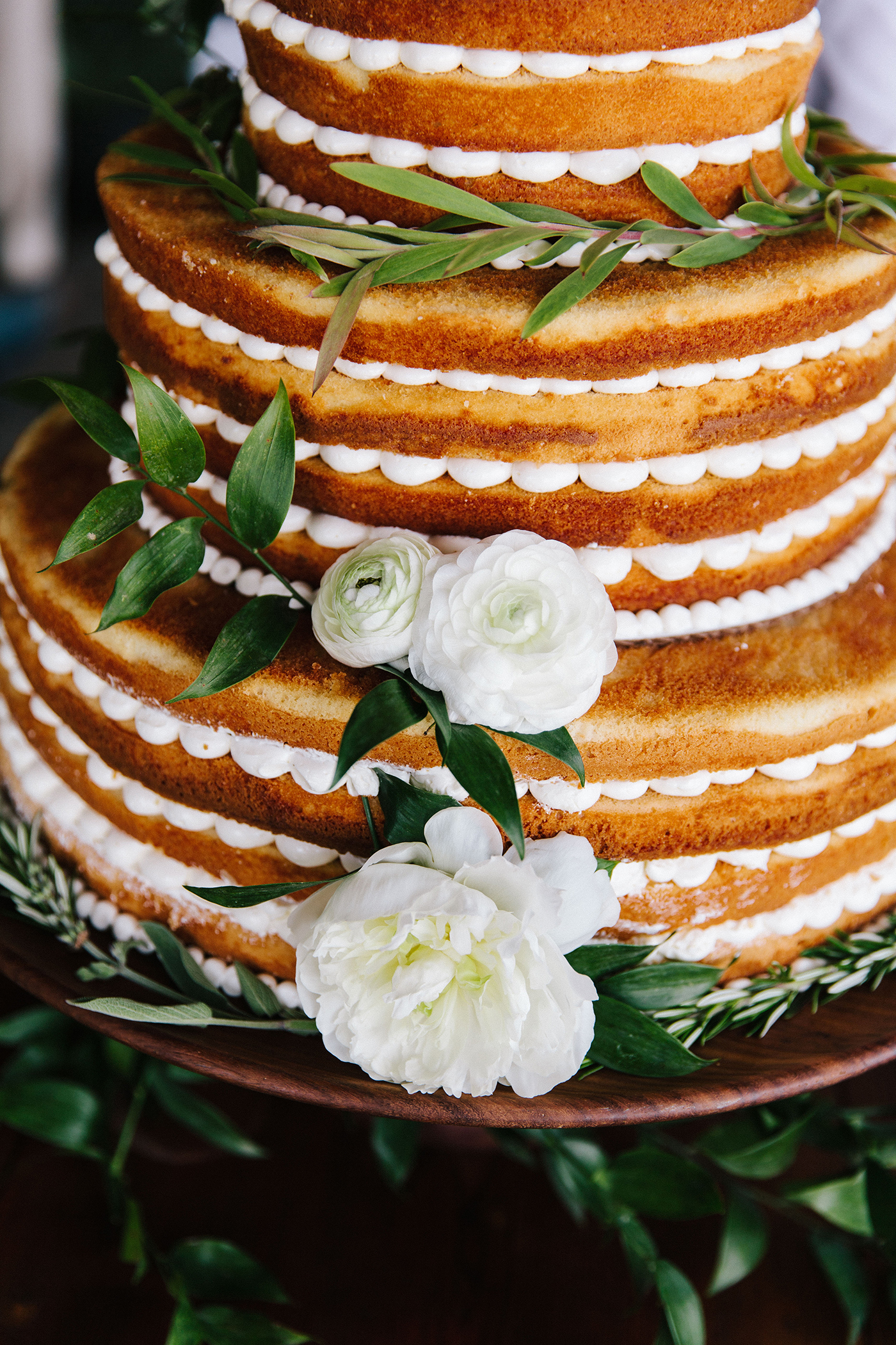 scalloped wedding decor naked cake with white flowers