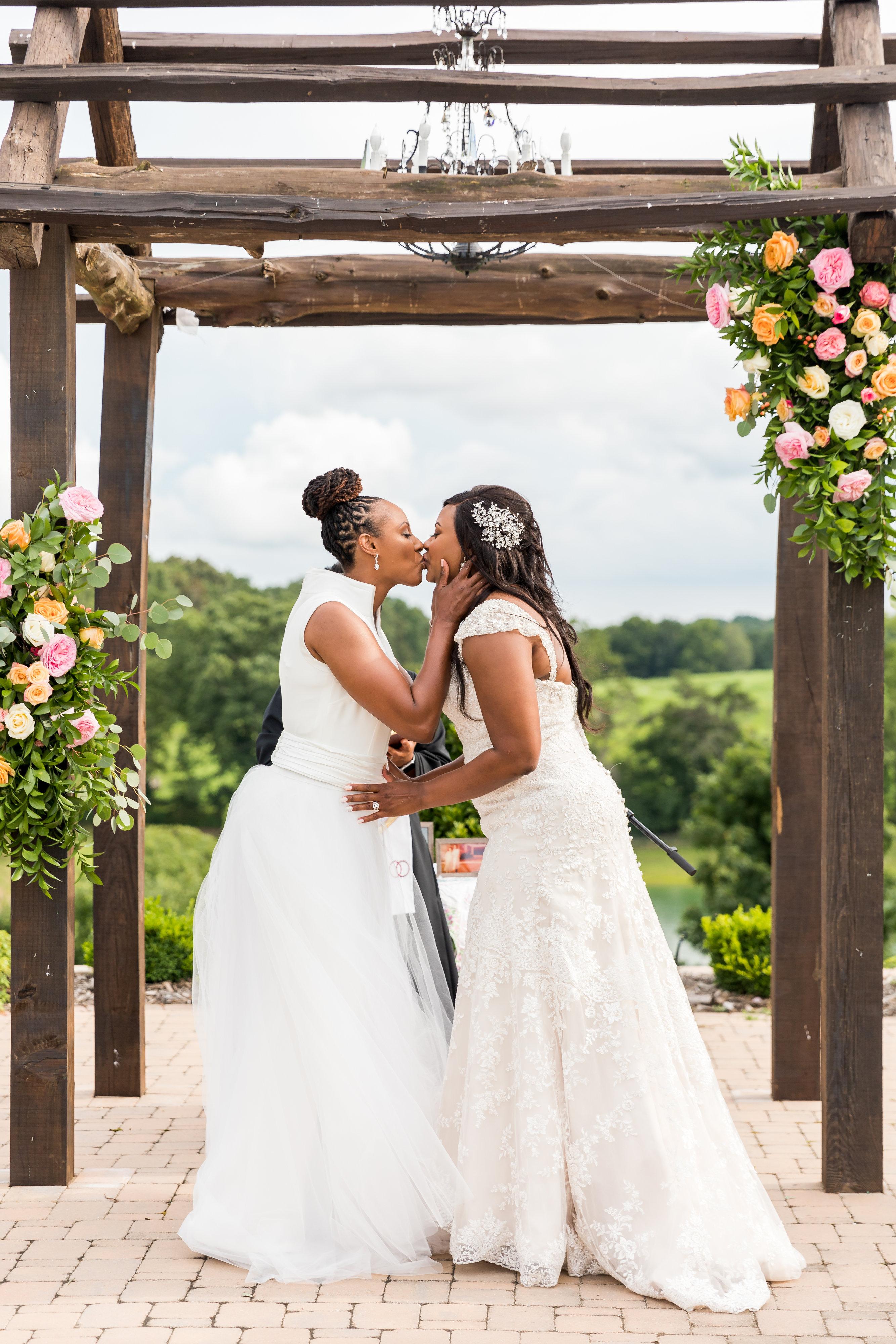 cara chamique wedding ceremony kiss
