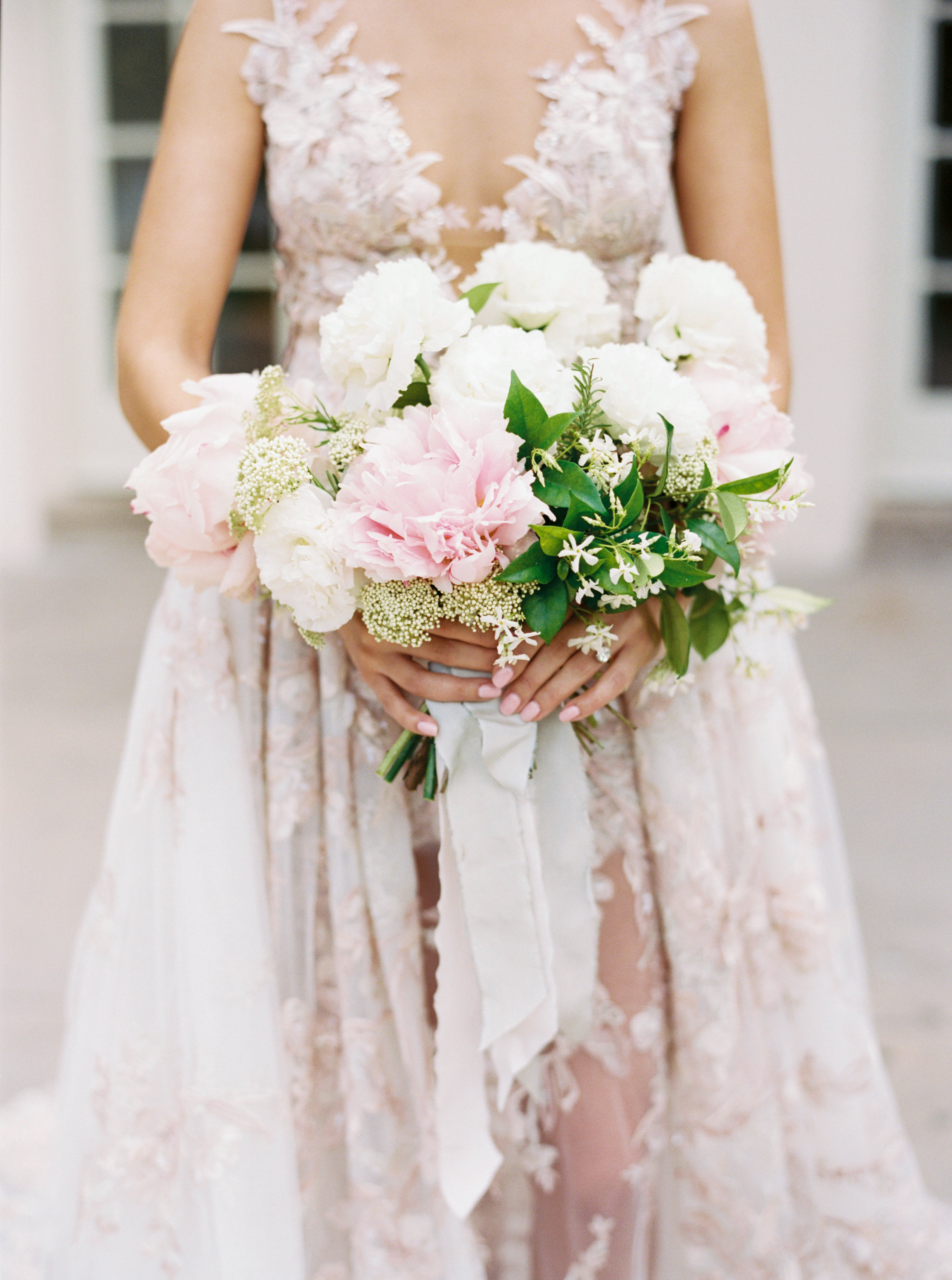 bridal bouquet of peonies jasmine and rice flowers with ribbon