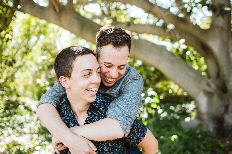 couple piggy back engagement photo