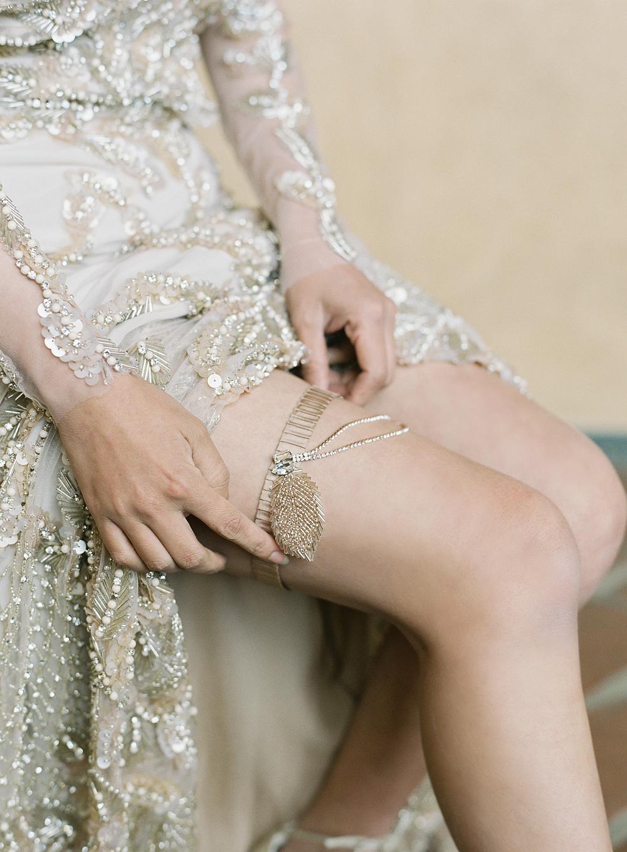 emme daji wedding bride adjusting gold garter