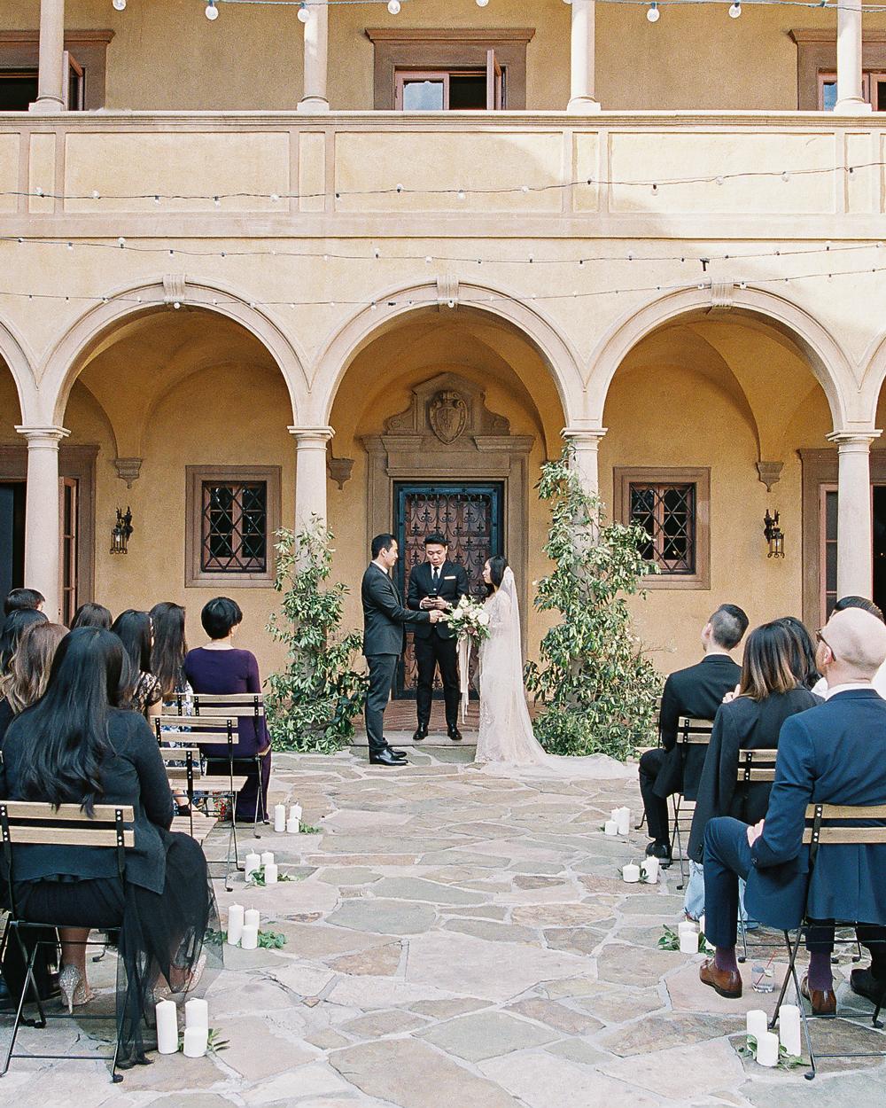 emme daji wedding ceremony under venue balcony