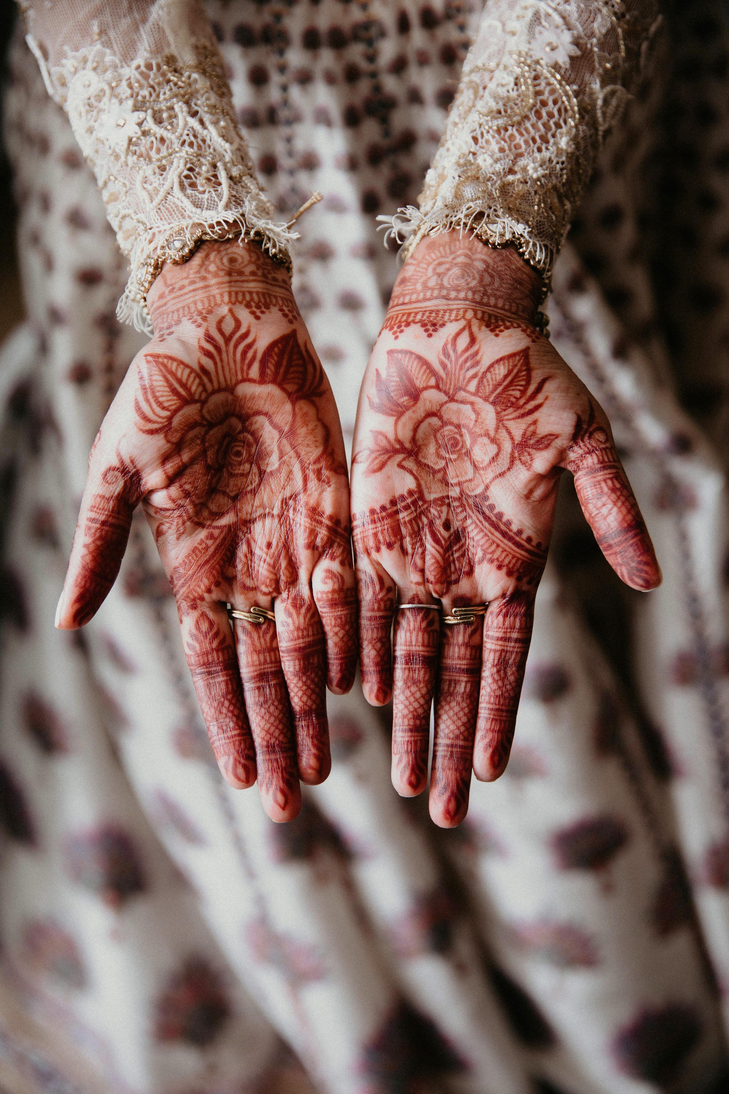 bride freestyle floral design on hands