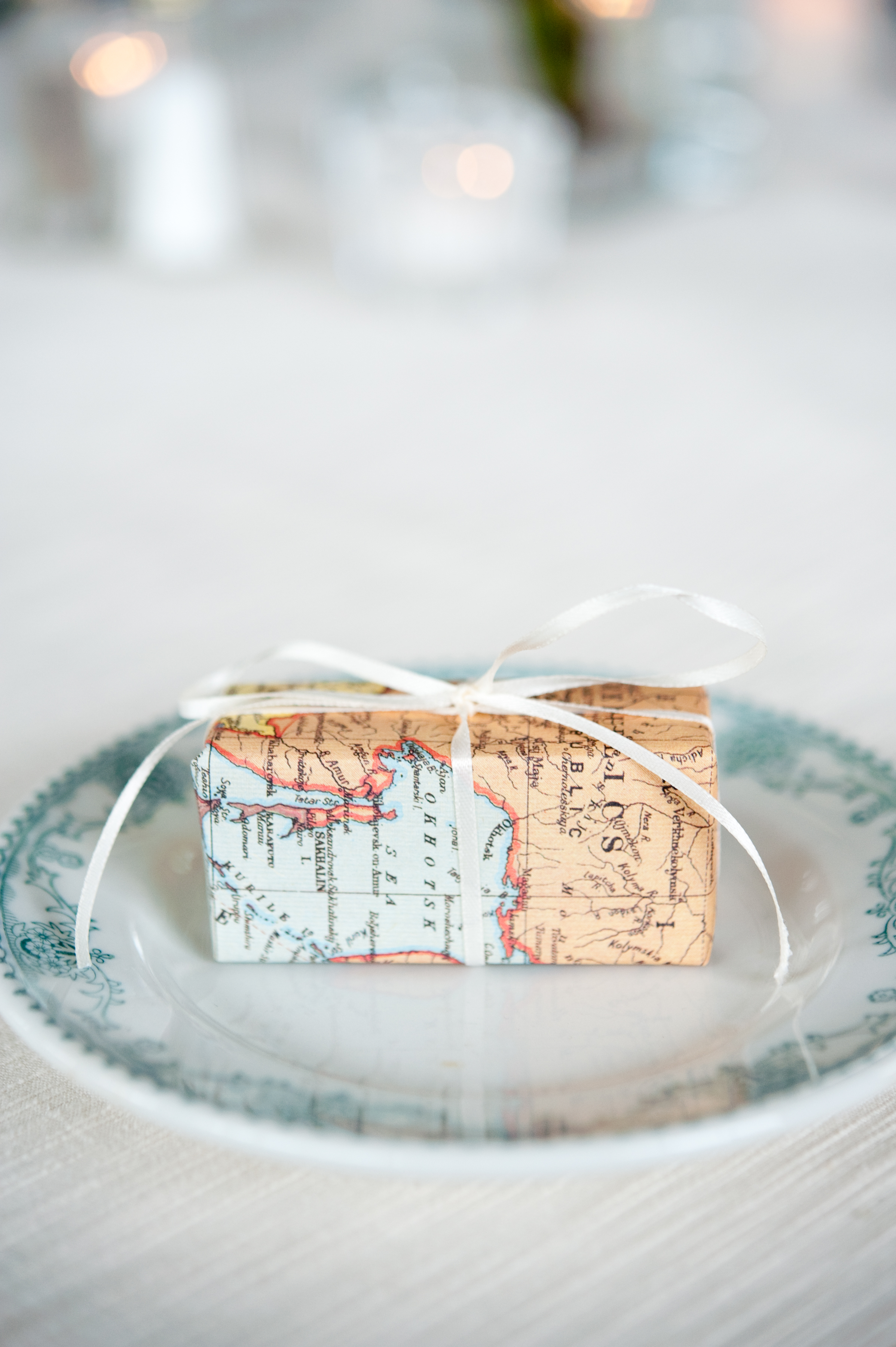 map gift box with white ribbon