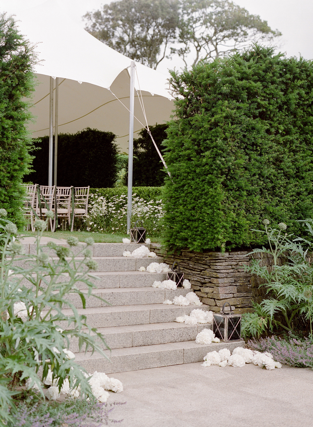 peony matthew england wedding entrance with flowers on stairs