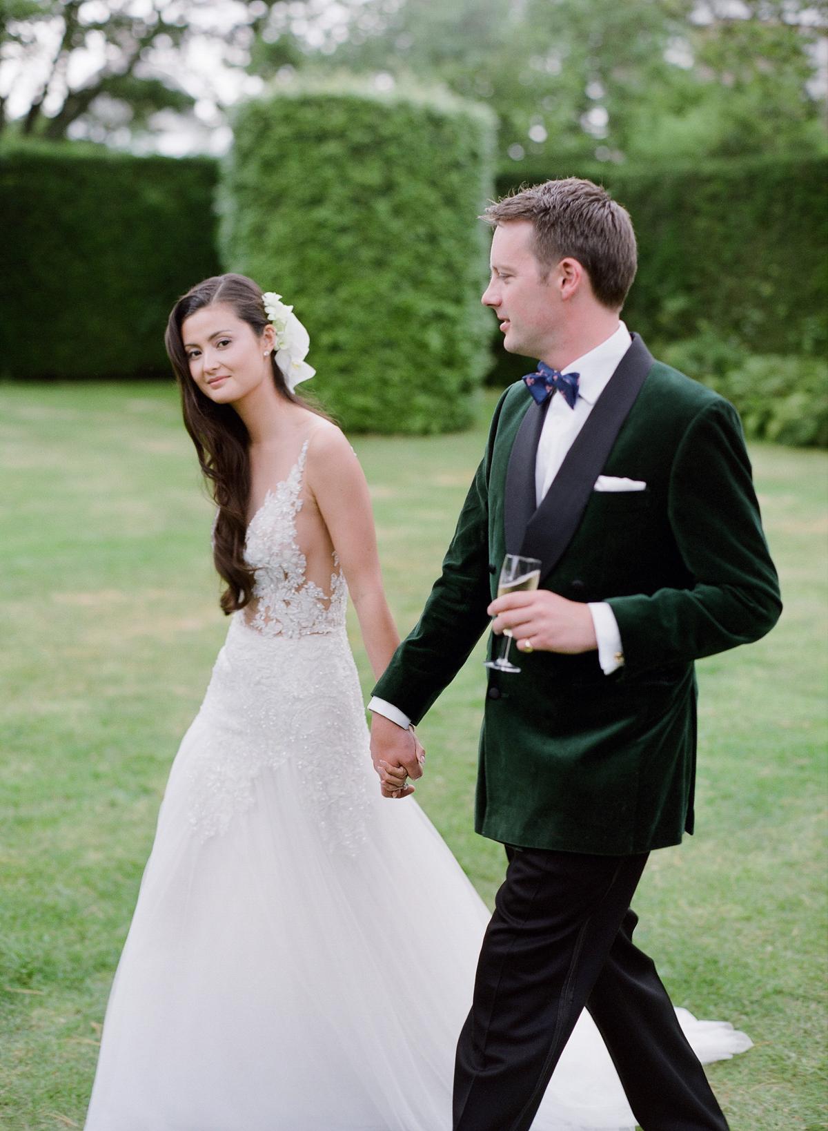 peony matthew england wedding couple in reception attire holding hands