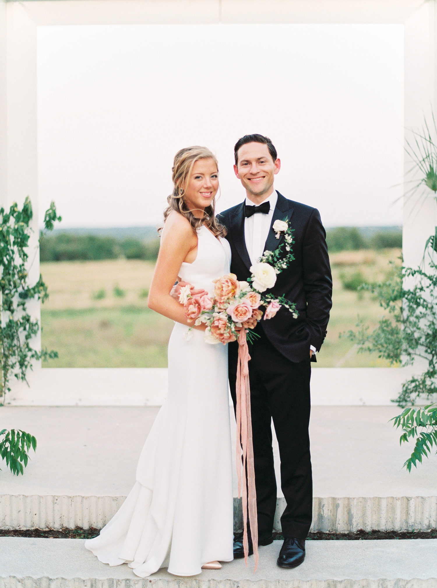 A Wedding Ceremony Framed Against Texas Hill Country