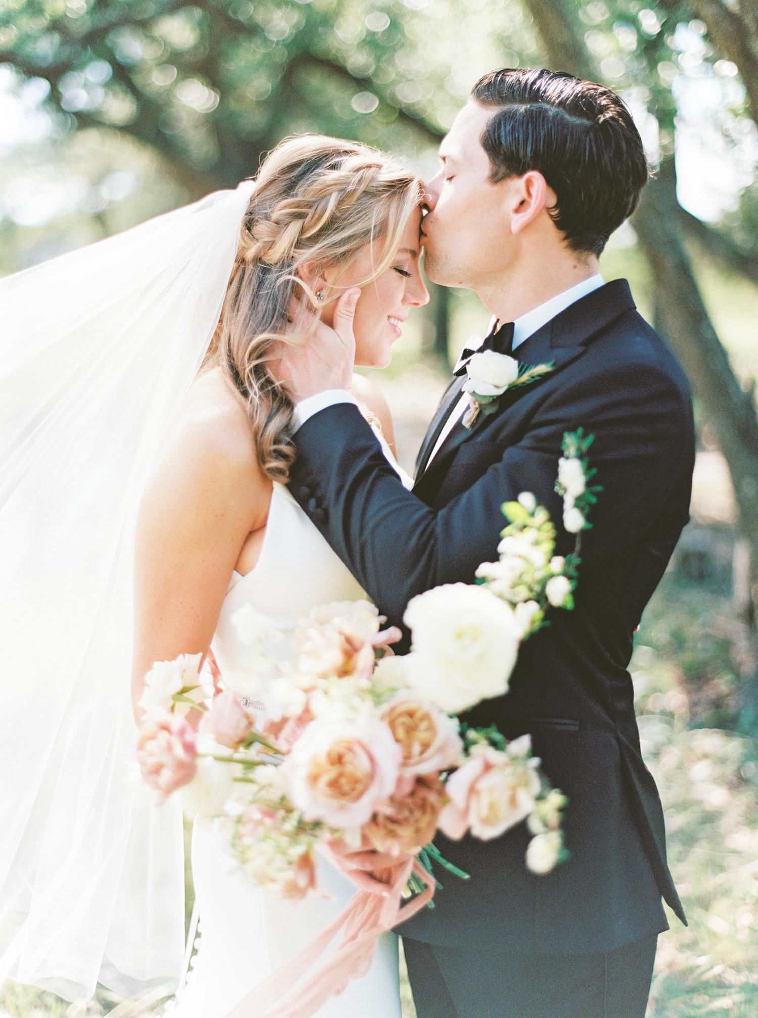 amanda chuck wedding couple forehead kiss under the trees